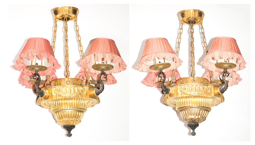 Lot image - Pair of Louis XVI Style Gilt and Patinated-Bronze Twelve-Light Chandeliers with Pink Silk Pleated Shades by Denning & Fourcade, Inc.