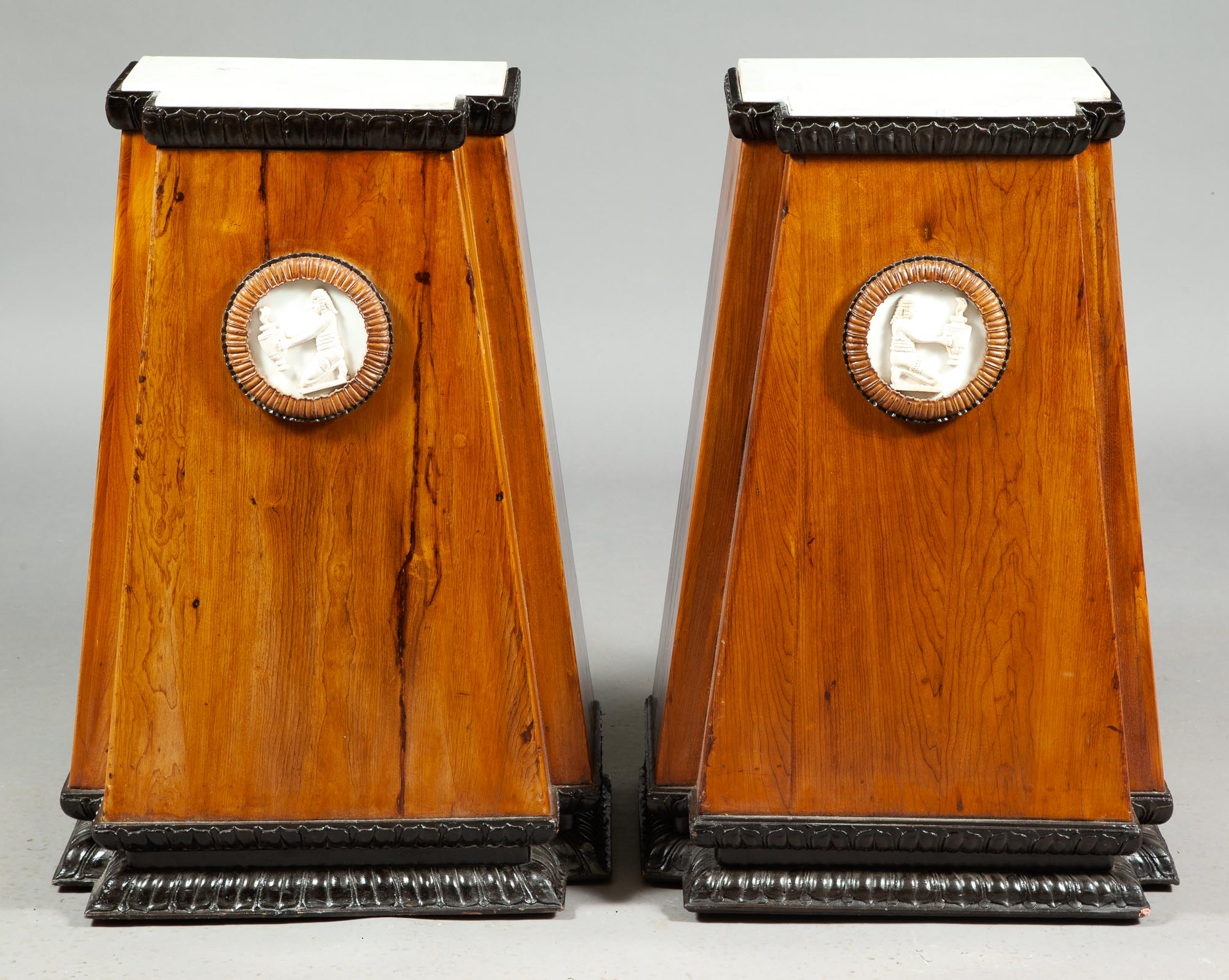 Lot image - Pair of Egyptian Revival Pine and Part-Ebonized Marble Top Pedestals