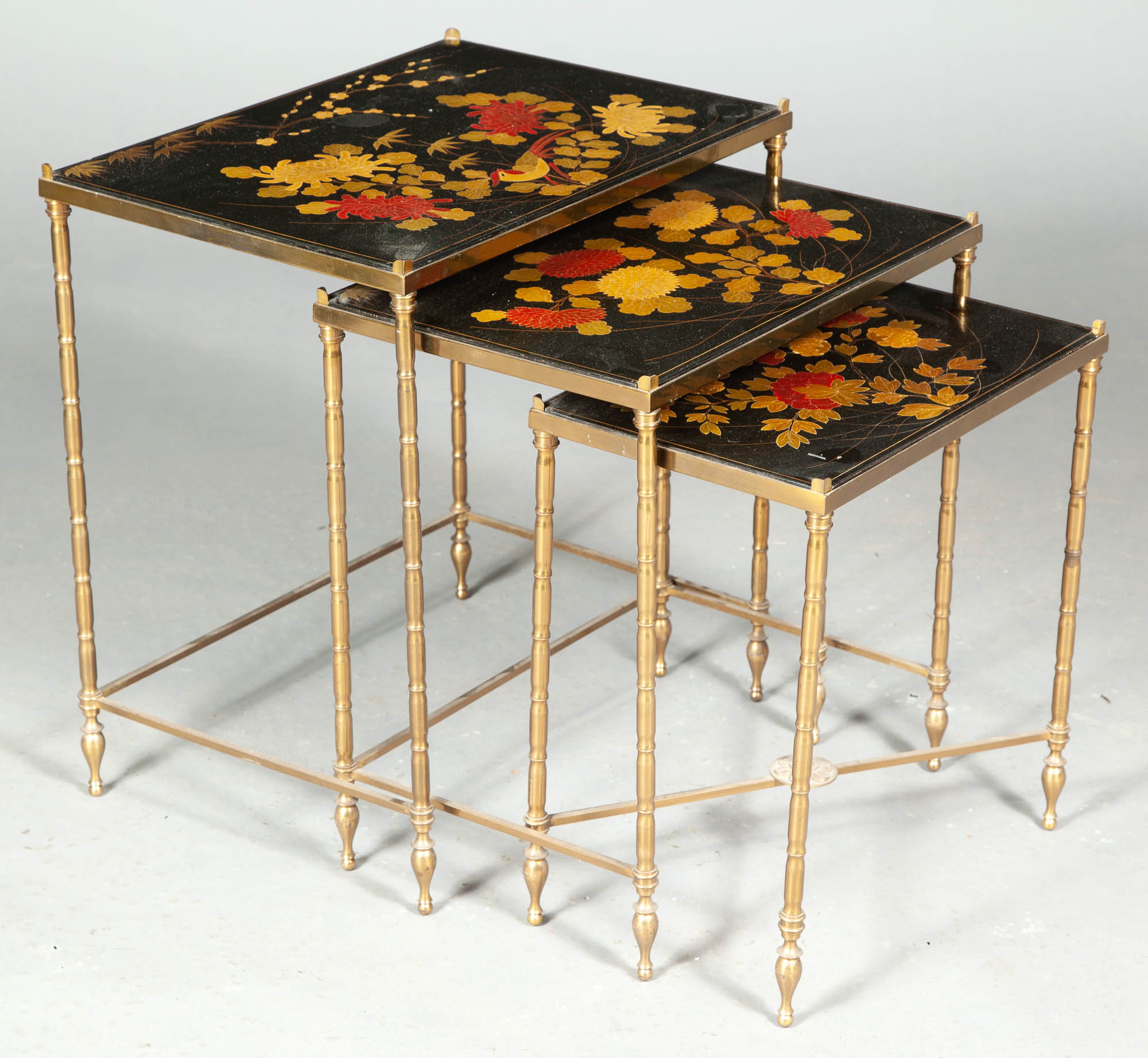 Lot image - Nest of Three Japanned, Parcel-Gilt and Gilt-Metal Occasional Tables