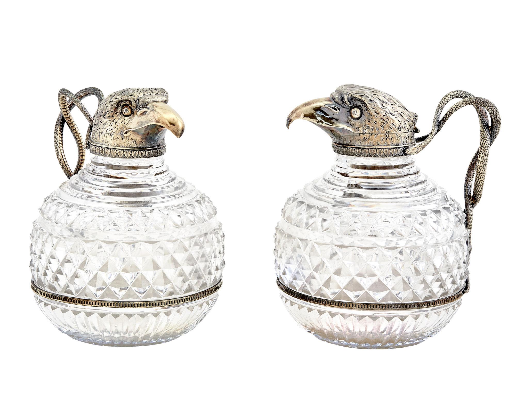 Lot image - Pair of George III Sterling Silver-Gilt Mounted Cut Glass Claret Jugs