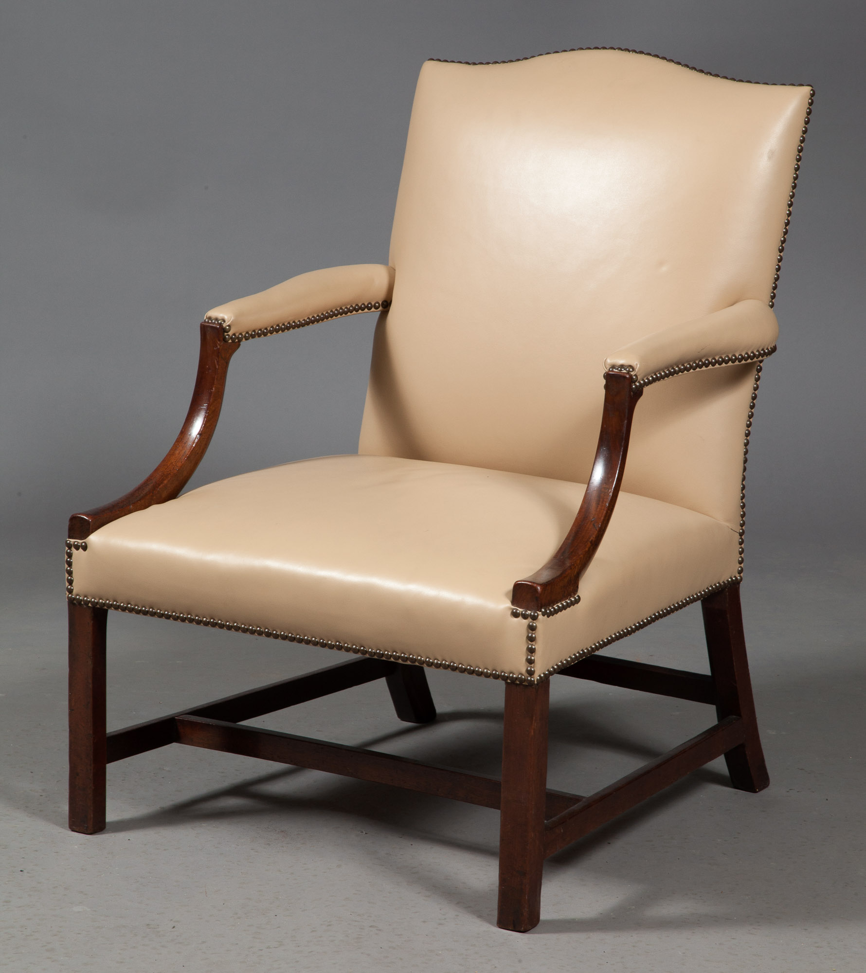 Lot image - George III Leather-Upholstered Mahogany Library Armchair