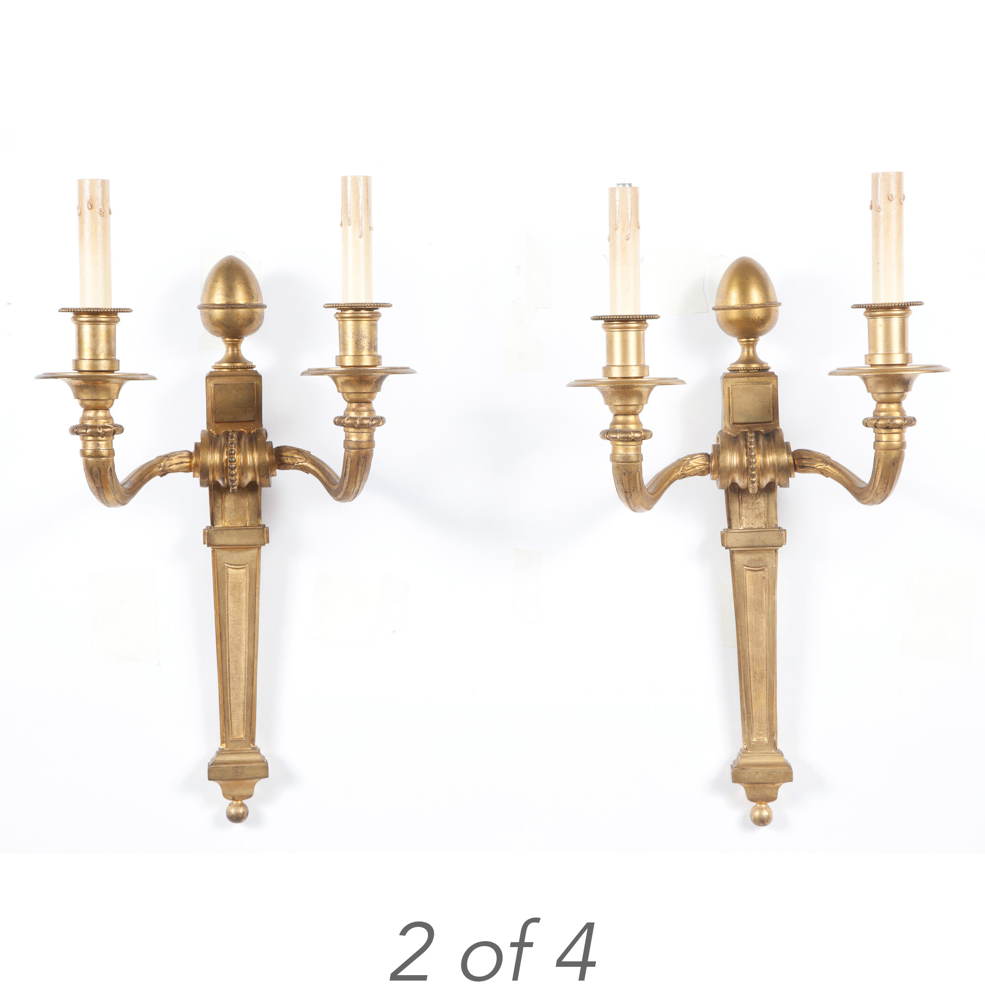 Lot image - Set of Four Neoclassical Style Gilt-Bronze Two-Light Sconces