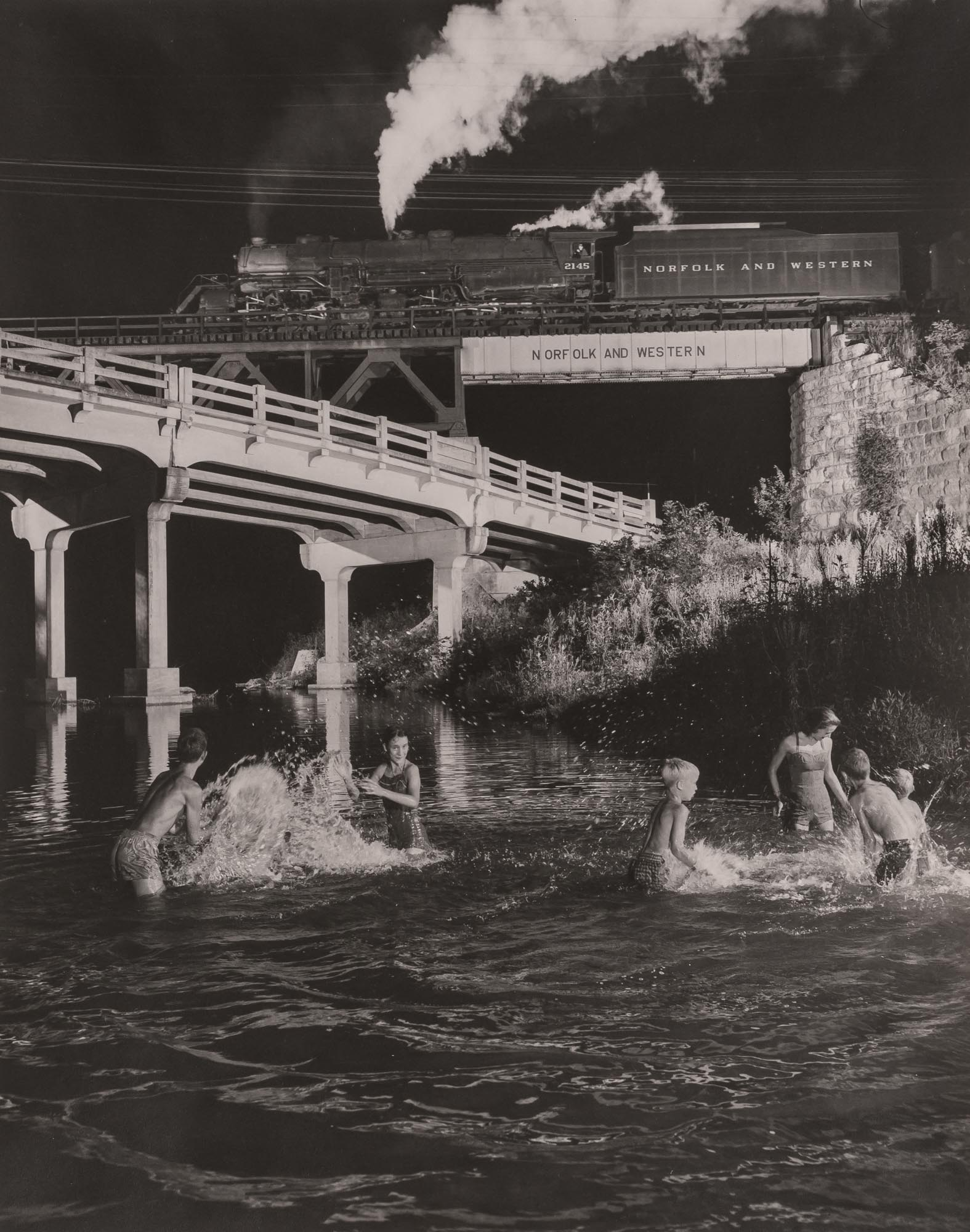 Lot image - LINK, O. WINSTON (1914-2001)  [Hawksbill Creek Swimming Hole, Luray, Virginia,  with No. 96 Northbound, 1956],
