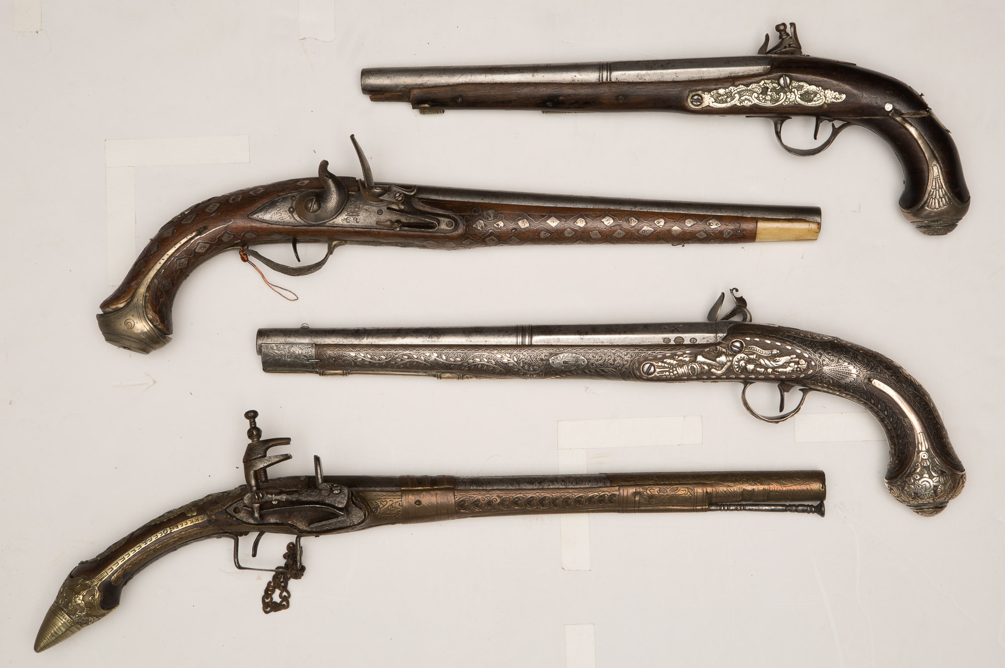 Lot image - Three Middle Eastern Style and one Balkan Rat Tail Pistols