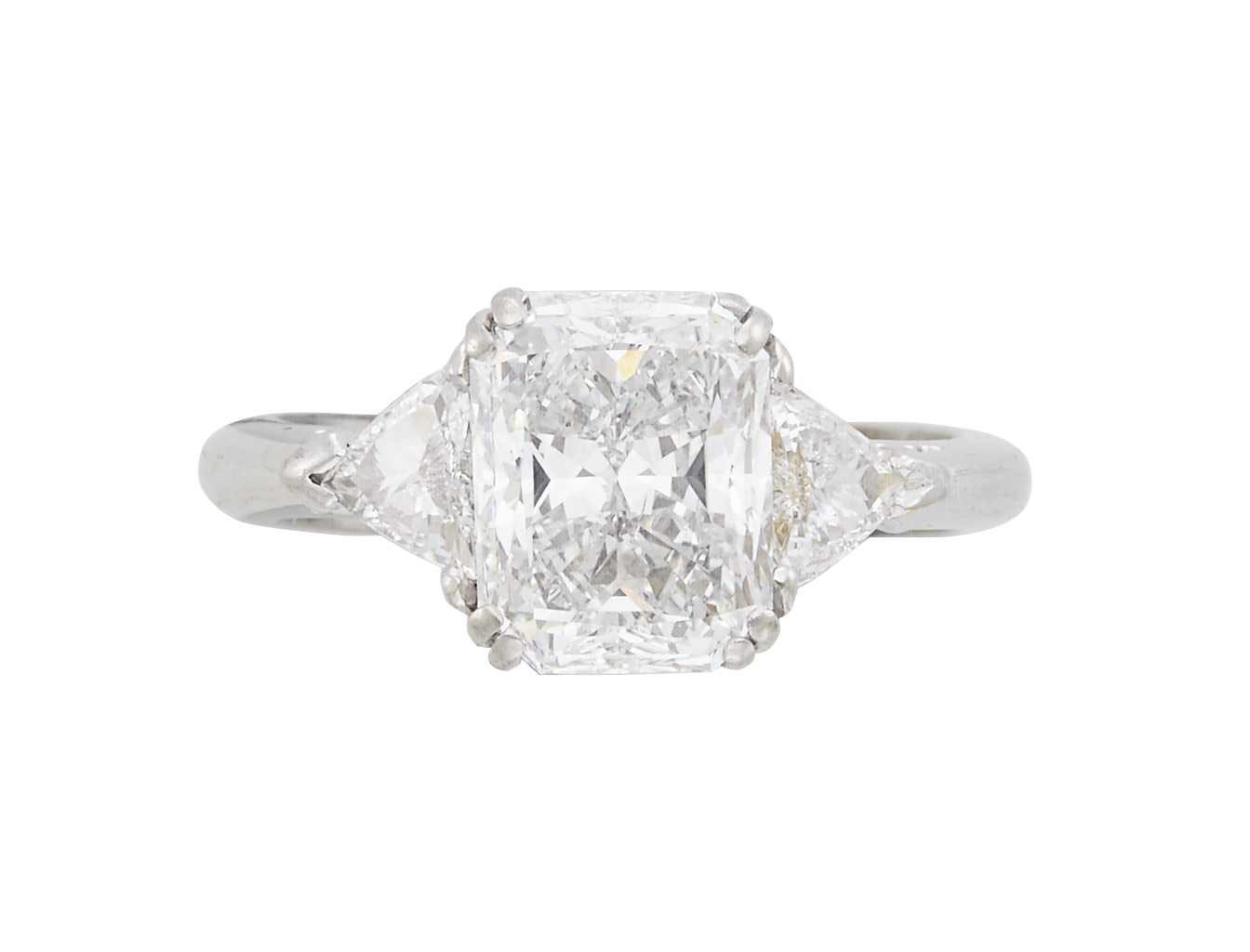 Lot image - Diamond Engagement Ring, 3 diamonds, center stone about 3.25 cts., 2 stones about 0.50 ct., Platinum 5 dwt.