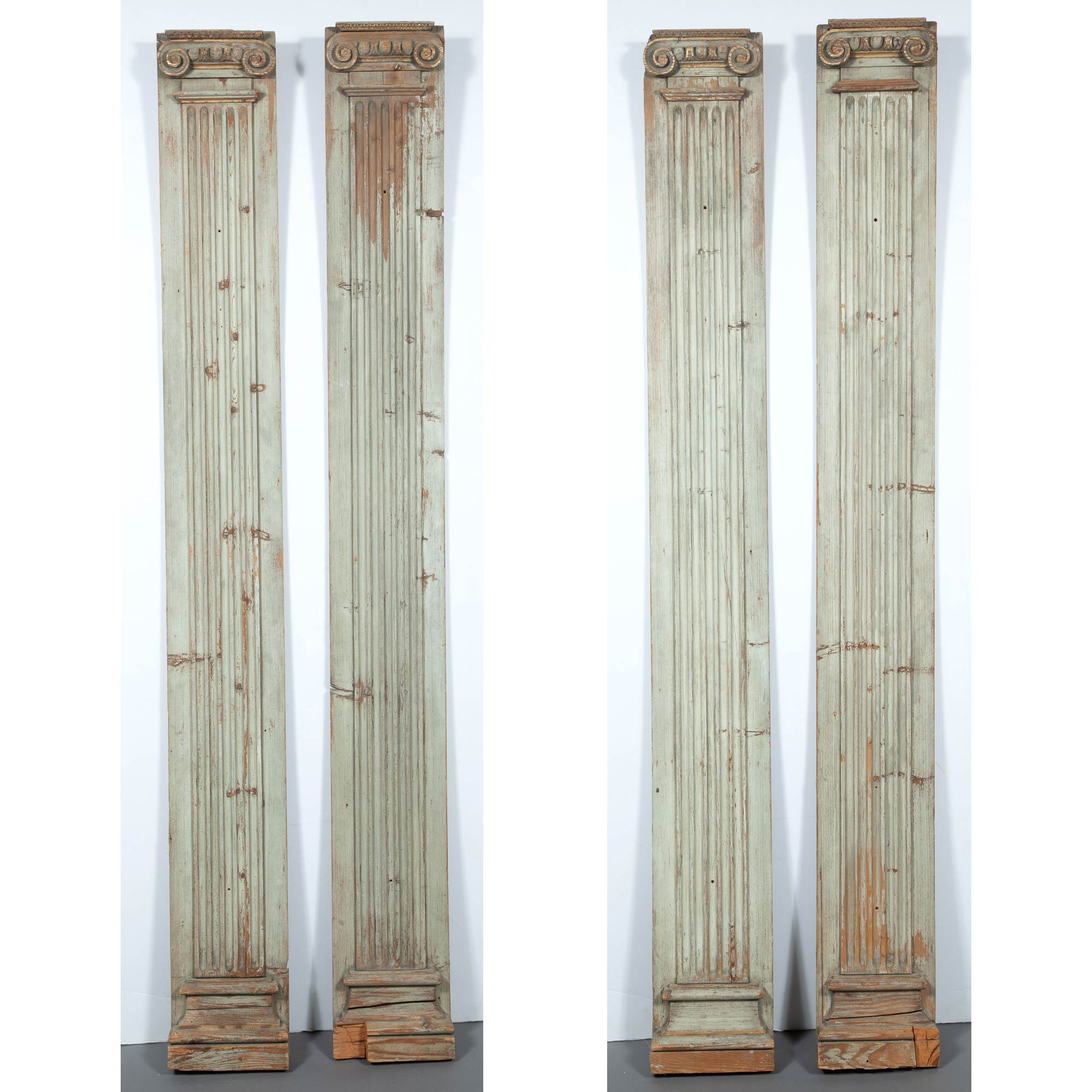 Lot image - Set of Four Painted and Parcel-Gilt Pilasters with Ionic Capitals