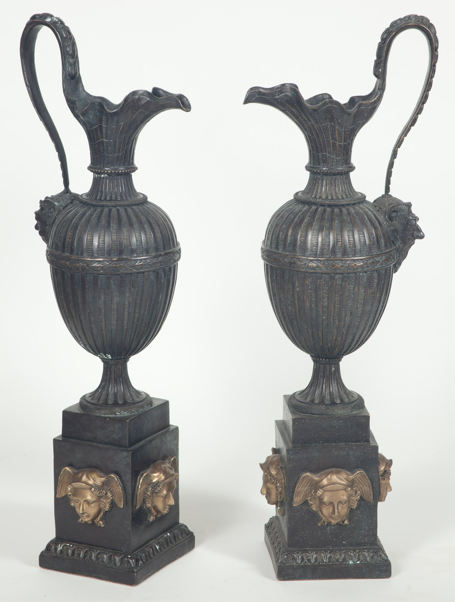 Lot image - Pair of Neoclassical Style Gilt and Patinated Bronze Ewers on Pedestals