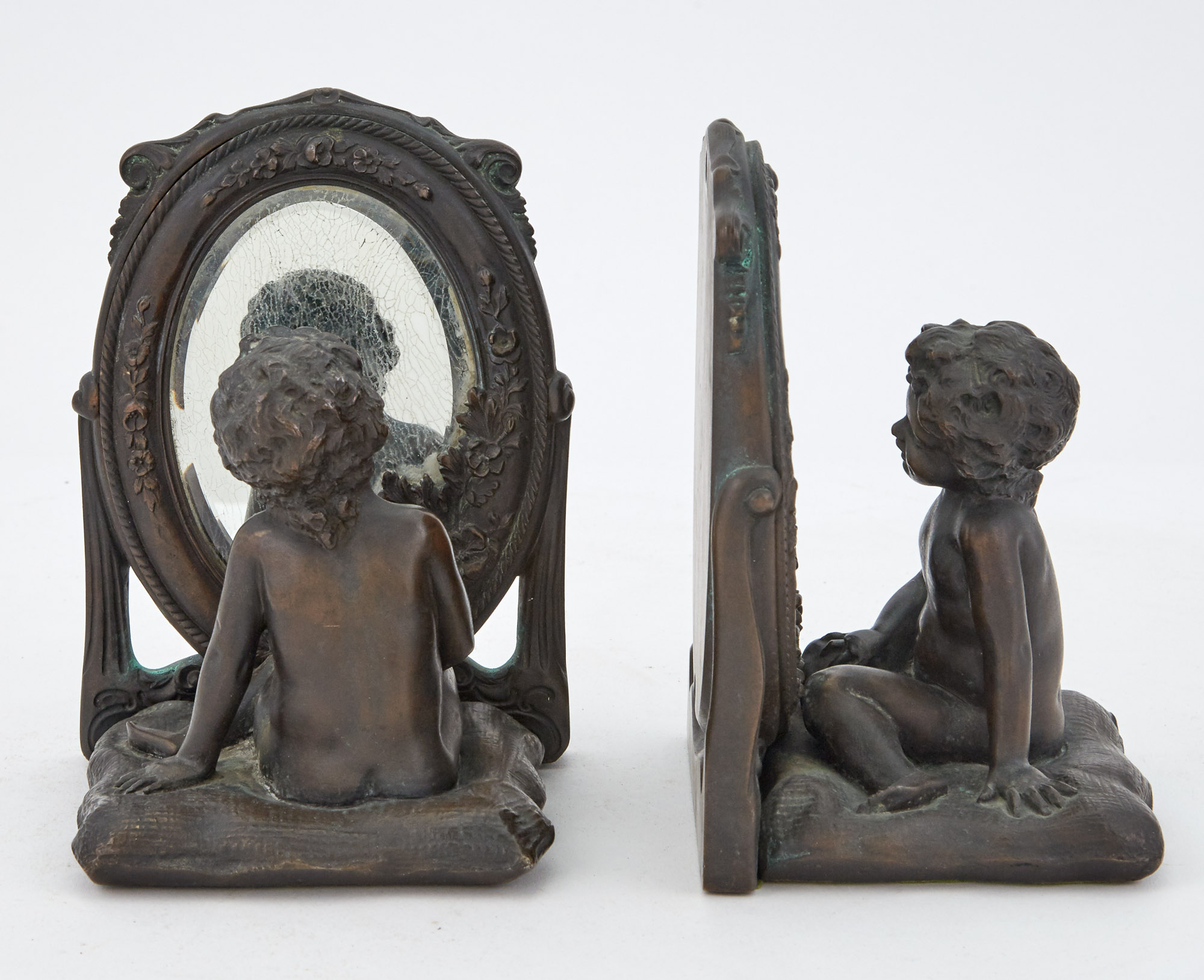 Lot image - Pair of Patinated Figural and Mirrored Bronze Bookends