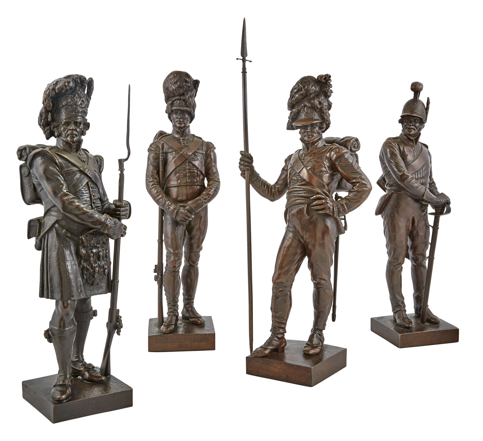 Lot image - Group of Four Victorian Bronze Patinated Metal Figures of Guards
