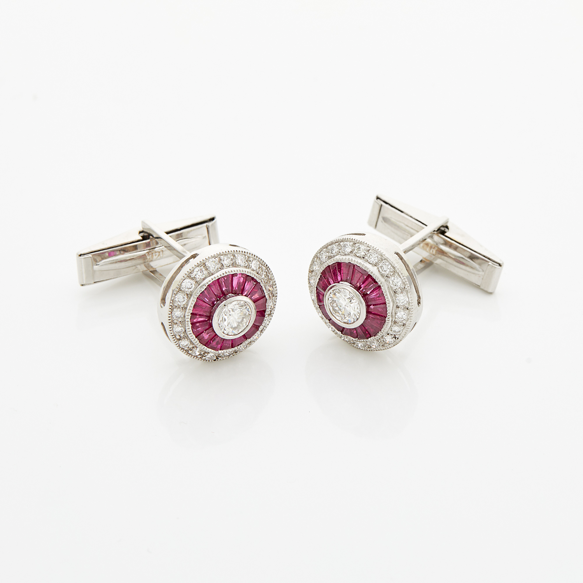 Lot image - Pair of White Gold, Diamond and Synthetic Ruby Cufflinks