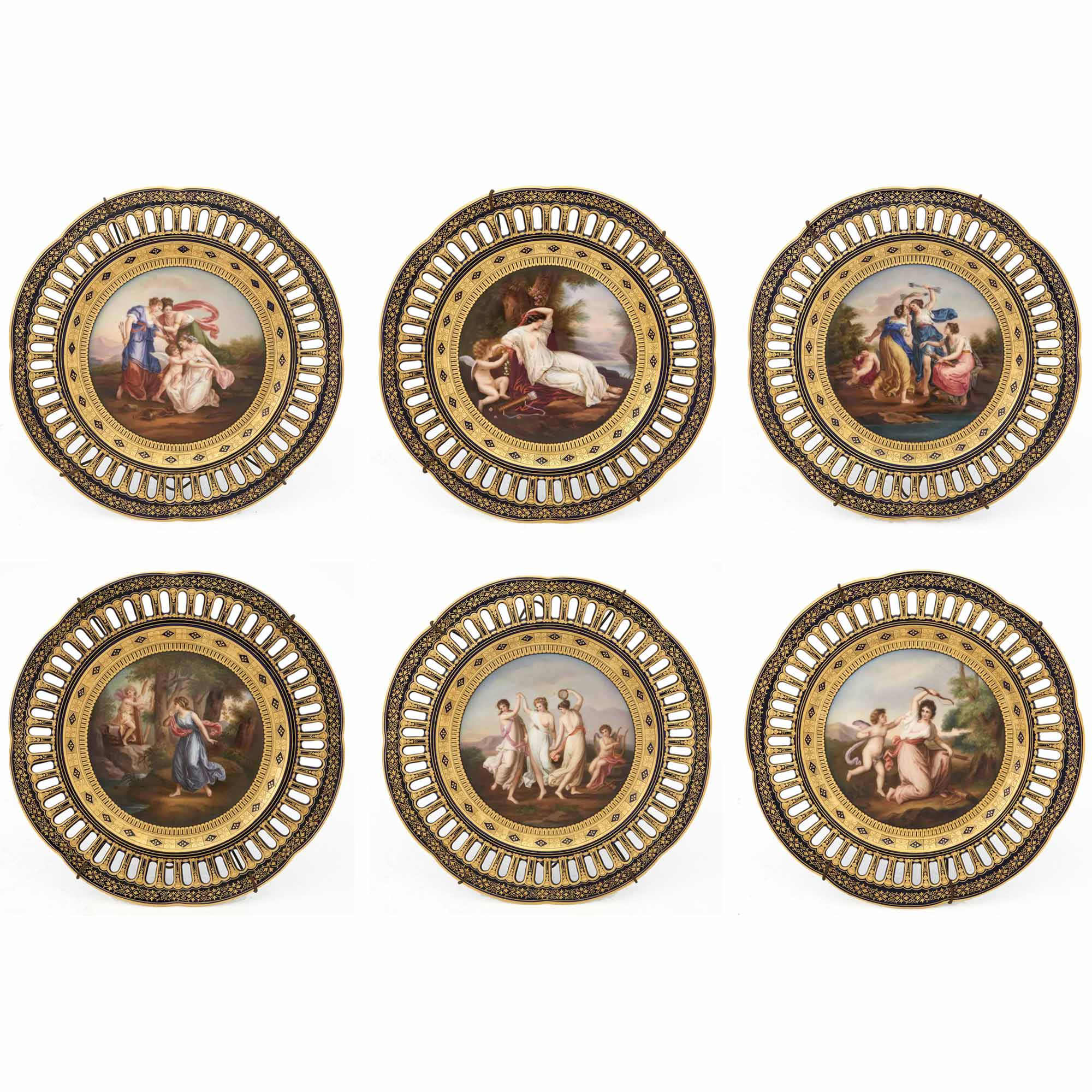 Lot image - Set of Six Pirkenhammer Gilt and Hand-Painted Cobalt Ground Reticulated Porcelain Cabinet Plates