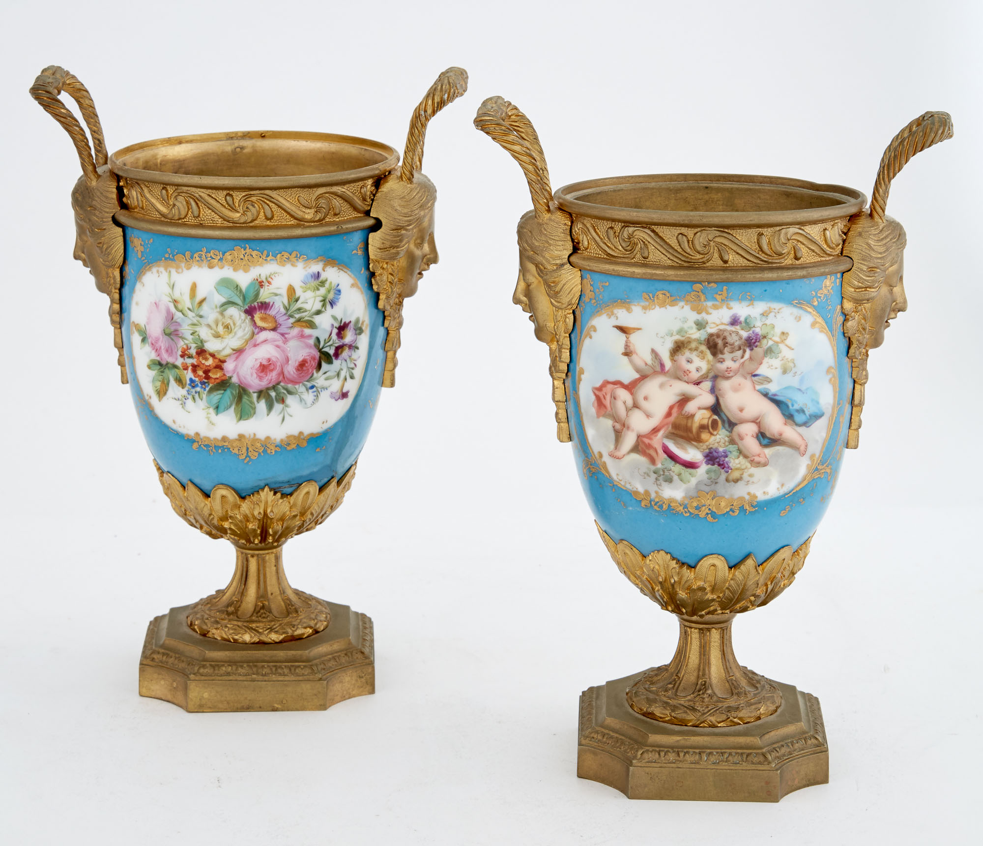 Lot image - Pair of Gilt-Metal Mounted Sèvres Style  Turquoise Ground Porcelain Garniture Two-Handled Urns