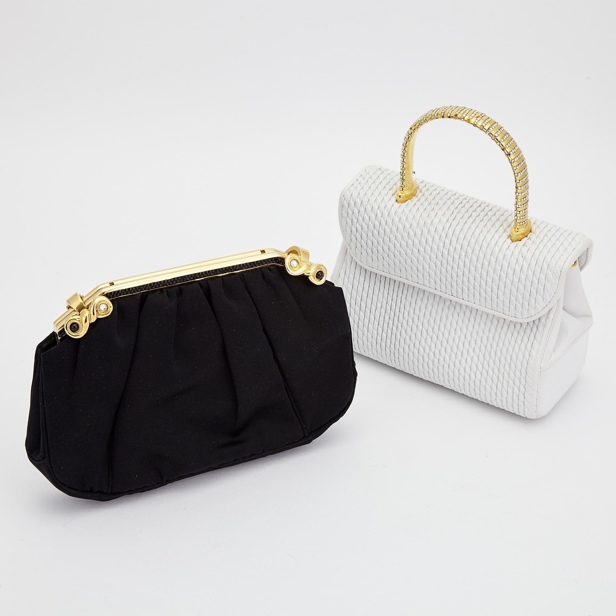 Lot image - White Leather Handbag and Black Satin Clutch, Judith Leiber