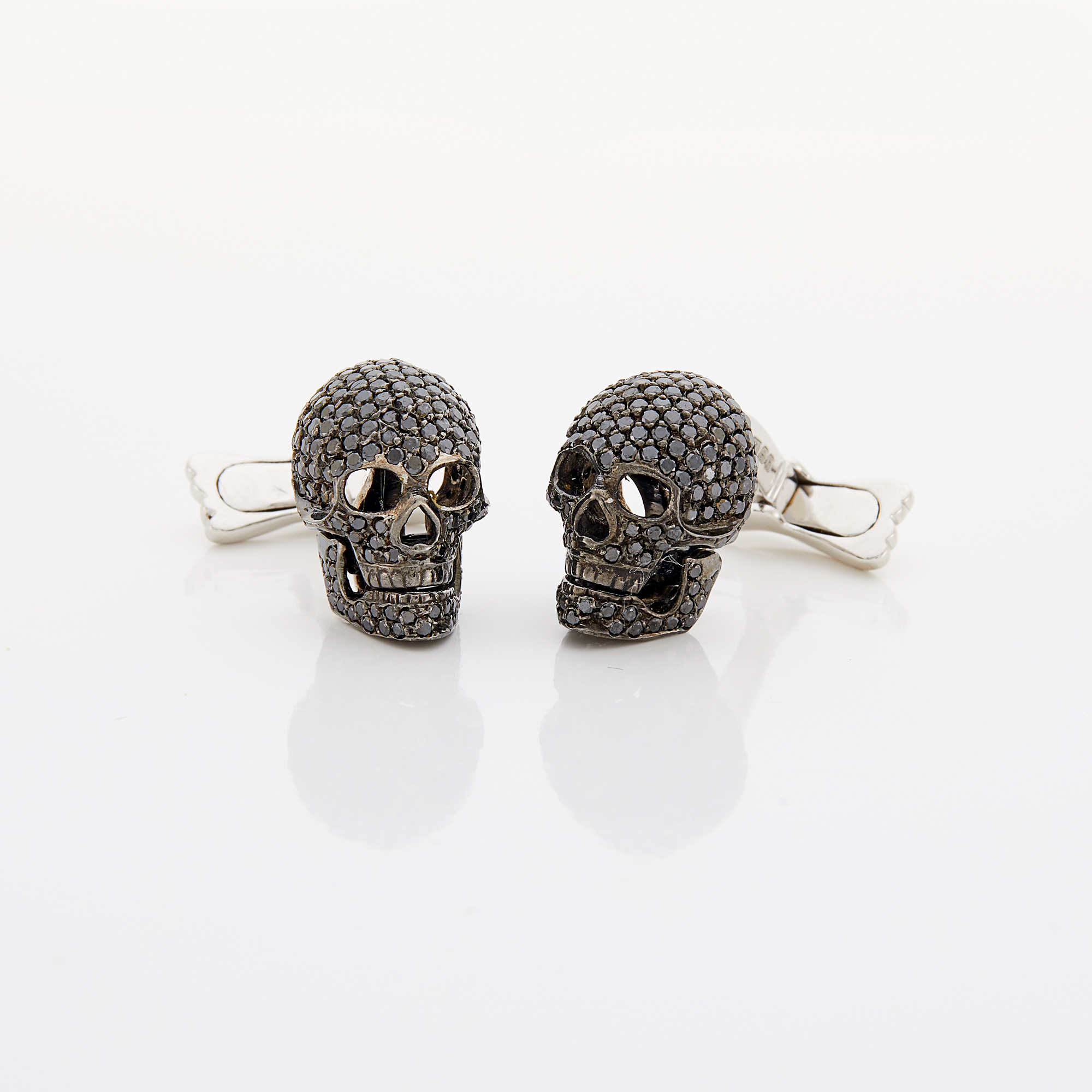 Lot image - Pair of White Gold and Black Diamond Skull Cufflinks, Deakin & Francis