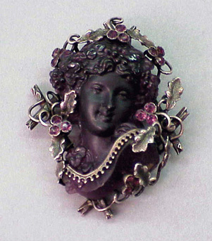 Lot image - Antique Female Head Glass Brooch