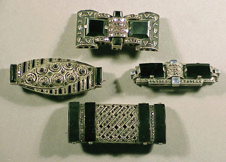 Lot image - Four Theodor Fahrner Onyx and Marcasite Pins