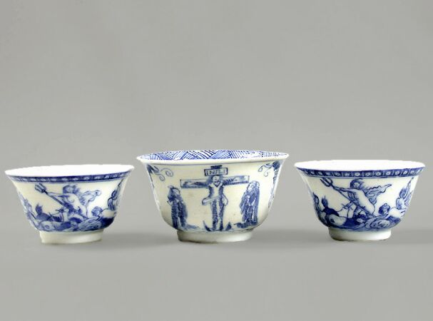Lot image - THREE CHINESE EXPORT BLUE AND WHITE EUROPEAN SUBJECT PORCELAIN TEA BOWLS  Qianlong Period, circa 1765-1775  Diameters 2 5/8, 3 1/8 inch