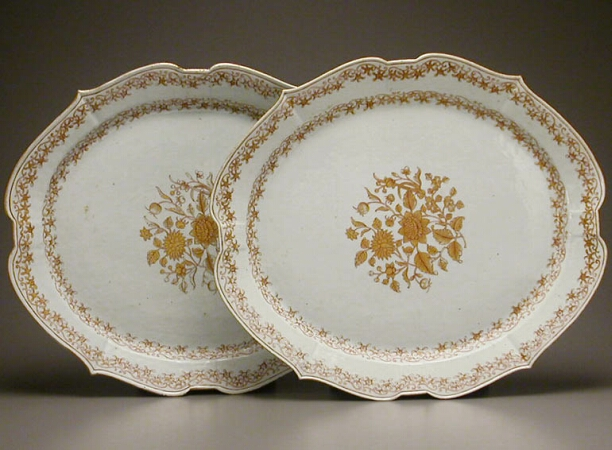 Lot image - PAIR OF CHINESE EXPORT GILT DECORATED PORCELAIN PLATTERS  Circa 1740  Length 19 7/8 inches (50.5 cm)