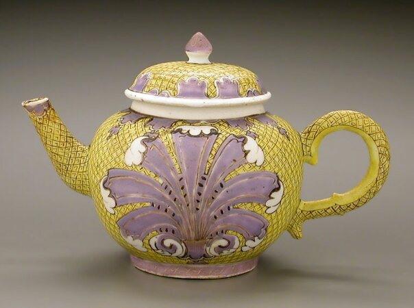 Lot image - RARE CHINESE EXPORT ENAMELED YELLOW GROUND PORCELAIN TEAPOT AND COVER  Qianlong Period, circa 1740  Height 4 3/4 inches (12.1 cm)