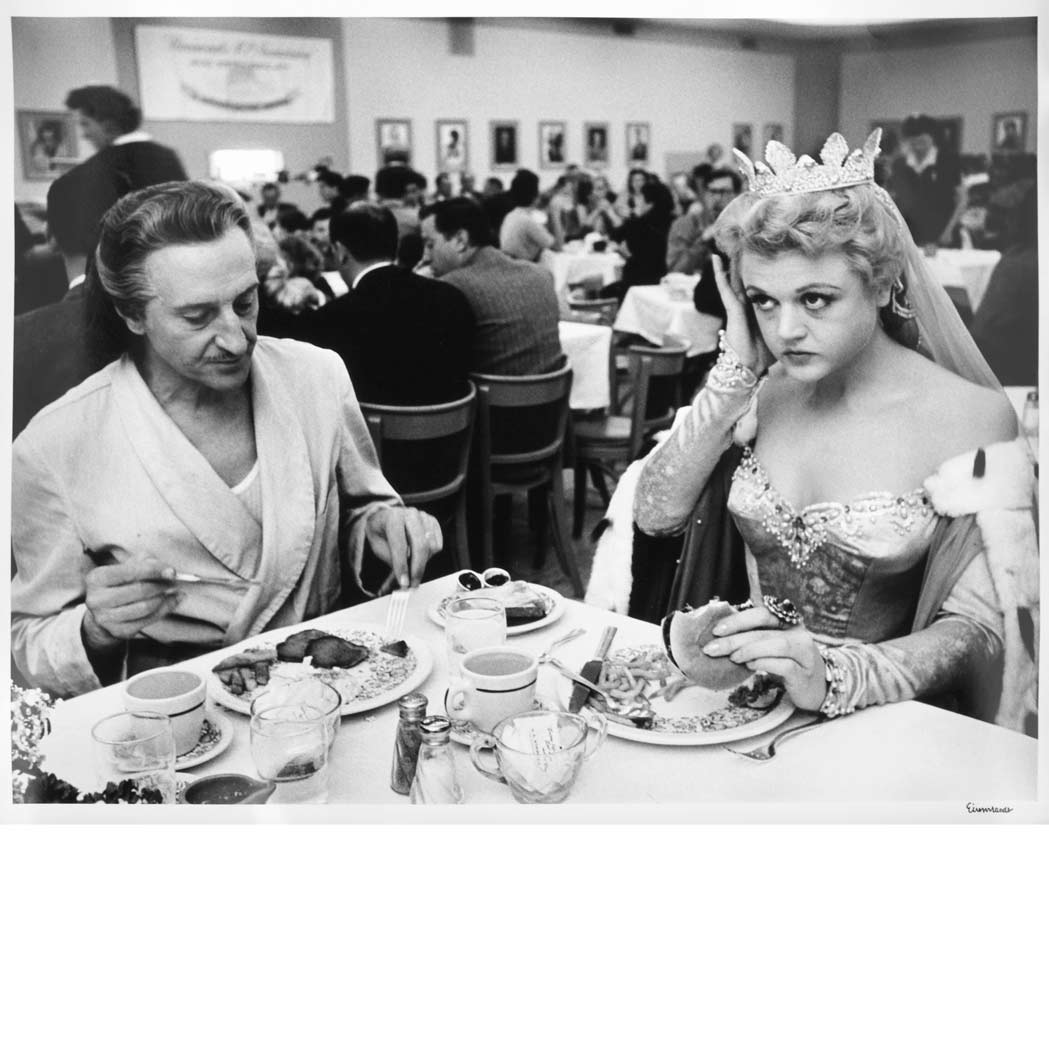 "Lot image - EISENSTAEDT, ALFRED (1898-1995)  Basil Rathbone and Angela Lansbury having lunch at Paramounts commisionary, Hollywood 1954.  The film they were acting in was ""The Court Jester"""