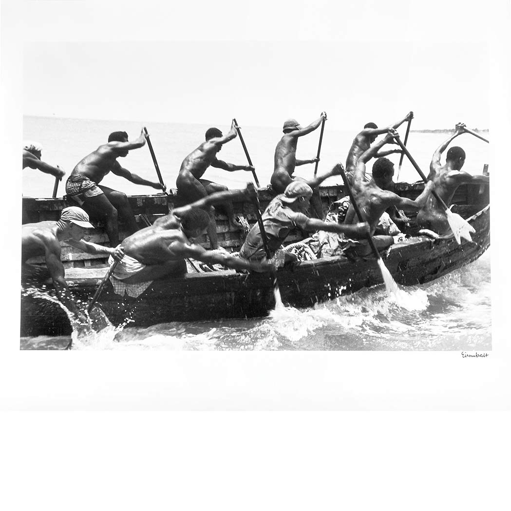 Lot image - EISENSTAEDT, ALFRED (1898-1995)  Tribesmen paddling cargo from ships to shore on Accra, Ghana, 1954
