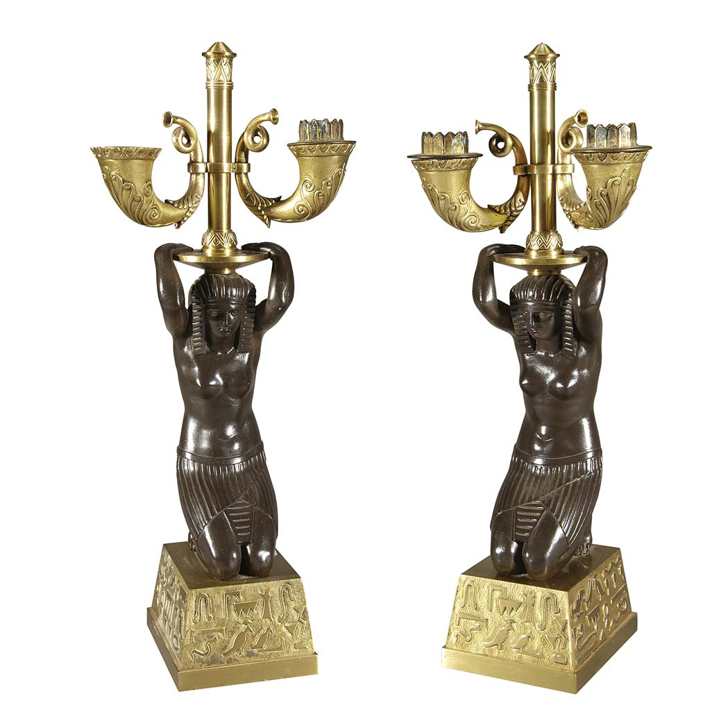 Lot image - Pair of French Empire Revival Gilt and Patinated-Bronze Two-Light Figural Candelabra