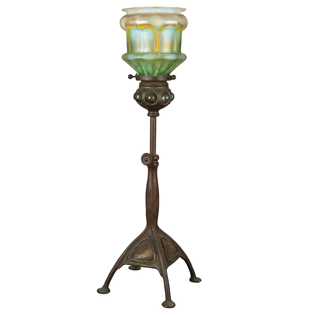 Lot image - Tiffany Studios Bronze and Favrile Glass Turtle Back Telescopic Candlestick Lamp; Together with a Quezal Ribbed Glass Shade