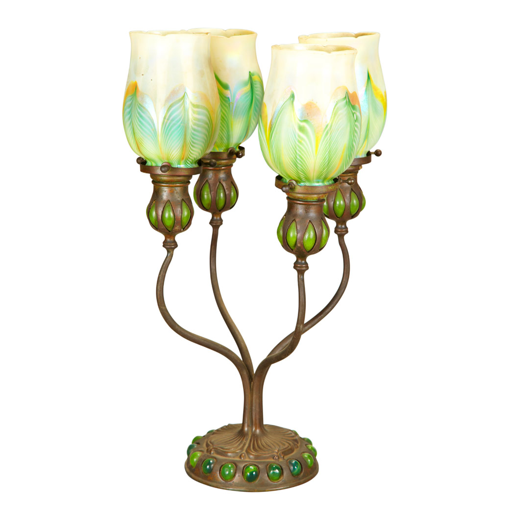 Lot image - Tiffany Studios Bronze and Favrile Glass Four-Light Blow-Out Candelabrum