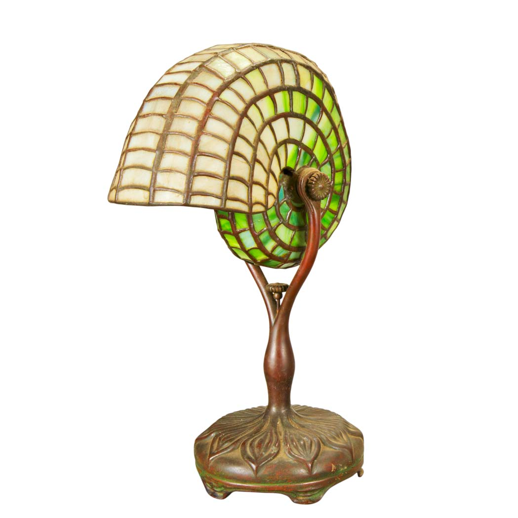 Lot image - Tiffany Studios Bronze and Leaded Favrile Glass Nautilus Shell Lamp
