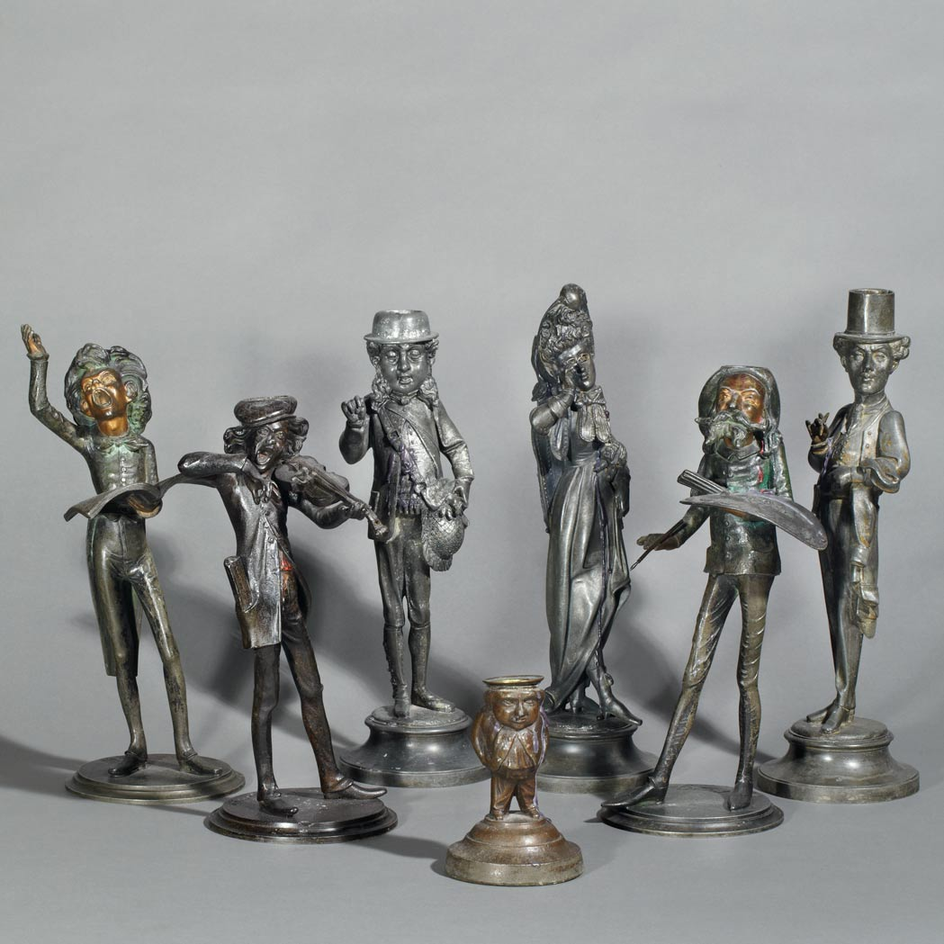 Lot image - Group of Seven Amusing Spelter Figural Candlesticks