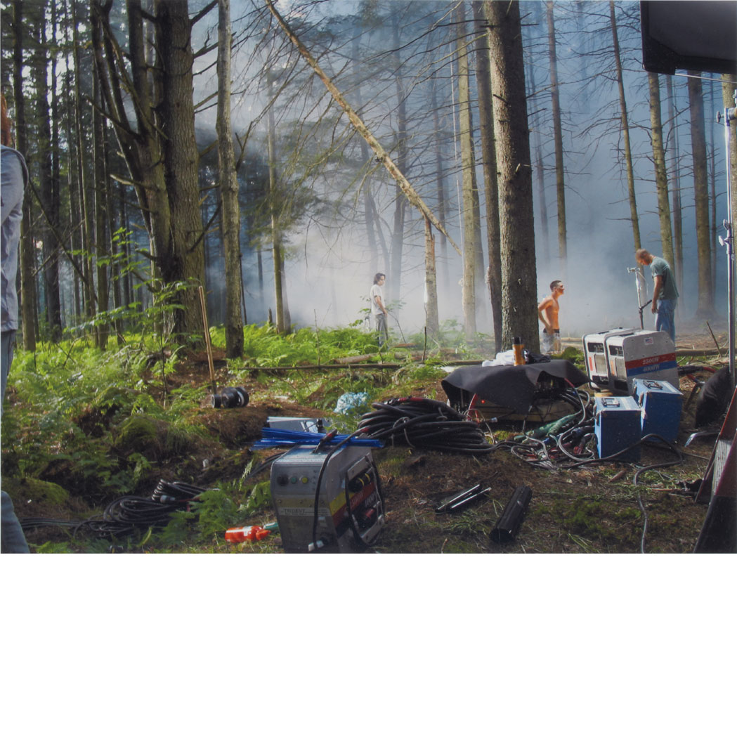 Lot image - CREWDSON, GREGORY (b. 1962) Production Still (Forest Gathering 31). Digital chromatic print, 11 7/8 x 15 7/8 inches (305 x 4...