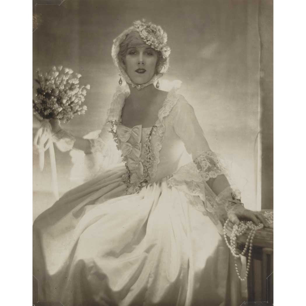 Lot image - DE MEYER, BARON ADOLPH (1868-1949)  [Olga de Meyer in Bridal Dress or possibly Mrs. Helen Lee Worthing, about 1920]