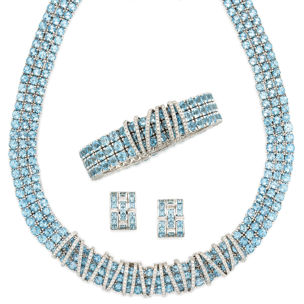 Lot image - White Gold, Blue Topaz and Diamond Necklace, Bangle and Pair of Earrings