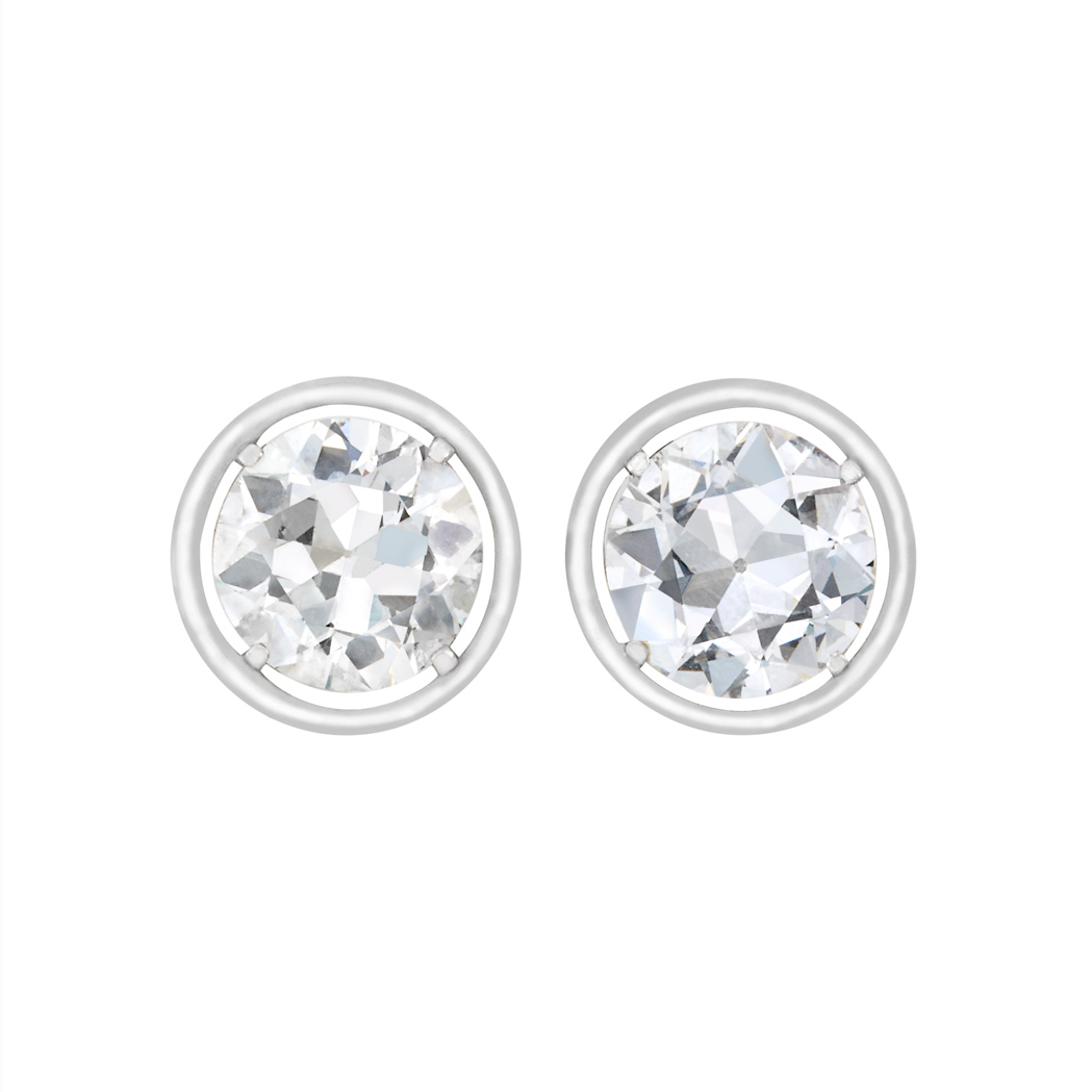 Lot image - Pair of Silver, White Gold and Diamond Stud Earrings