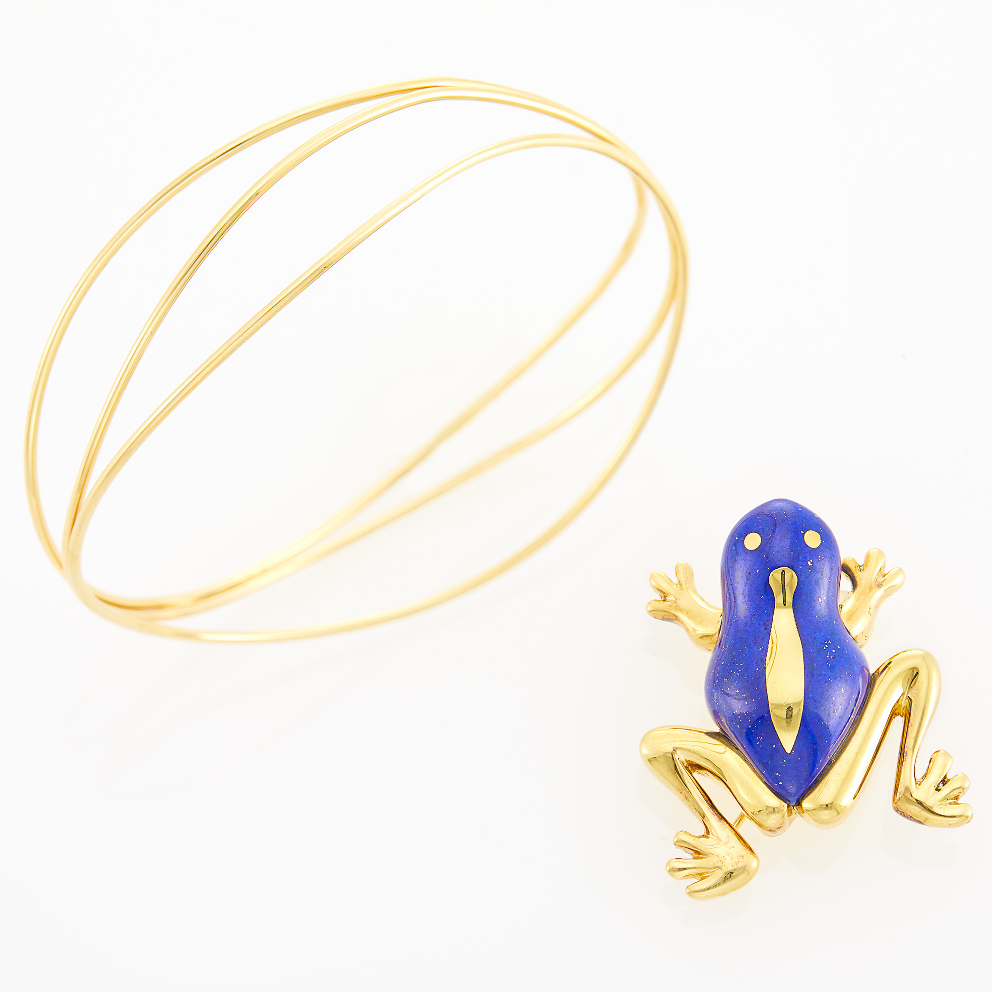 Lot image - Tiffany & Co., Elsa Peretti Gold Bangle Bracelet and Tiffany & Co. Gold and Lapis Frog Pin