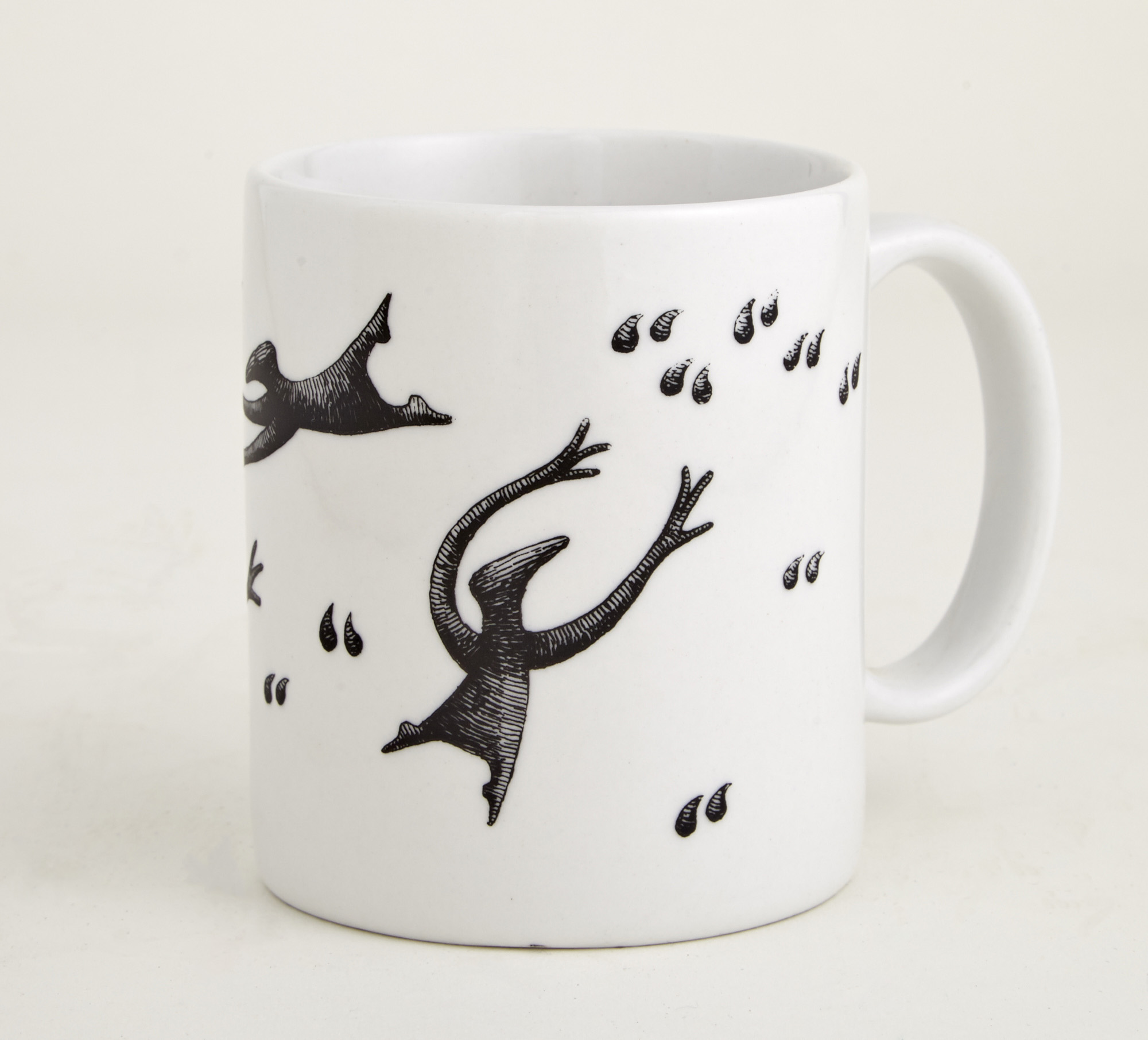 Lot image - [GOREY, EDWARD]  Group of Twelve Figbash Inverted Comma coffee mugs.