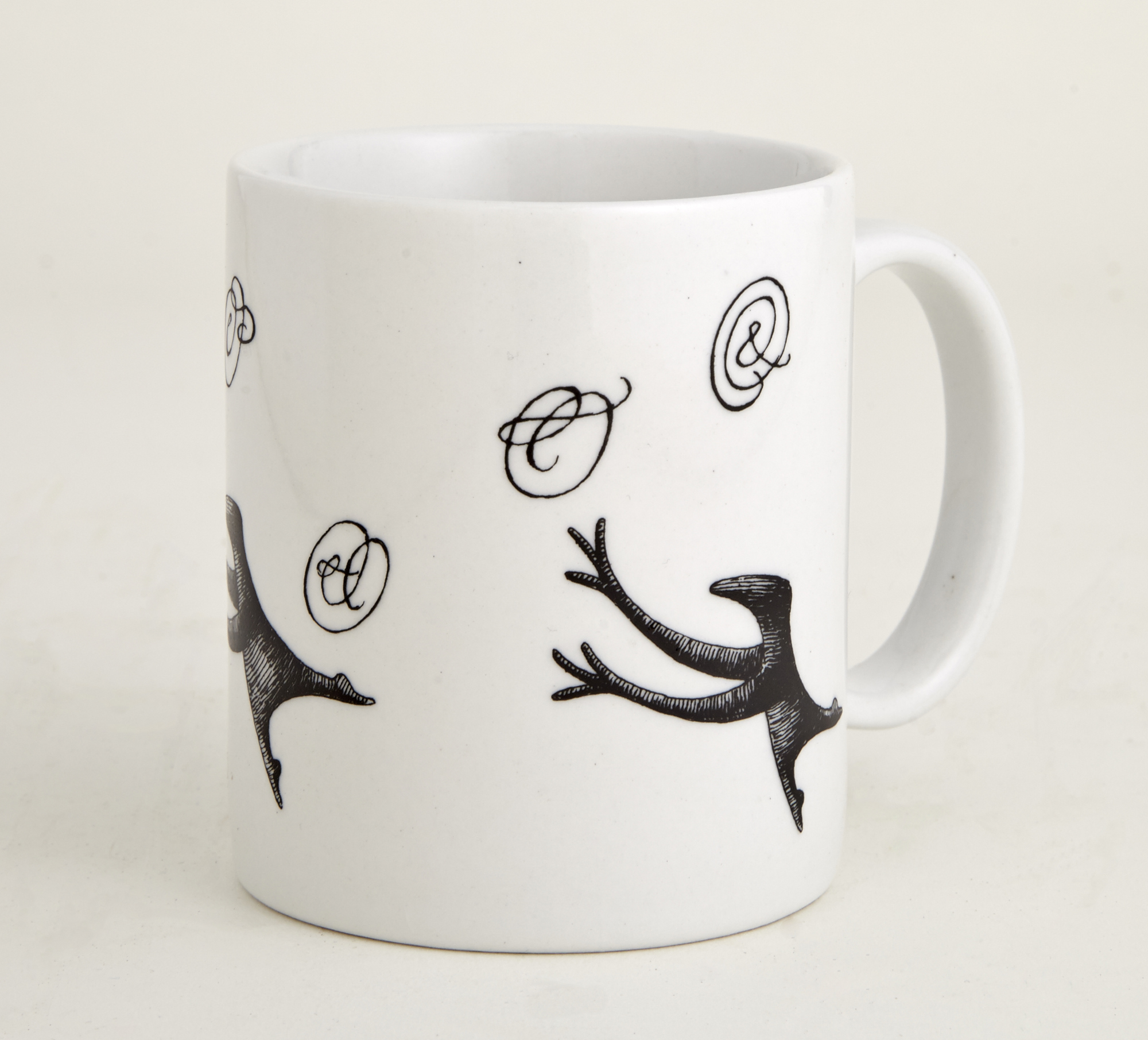 Lot image - [GOREY, EDWARD]  Group of Twelve Figbash Ampersand coffee mugs.