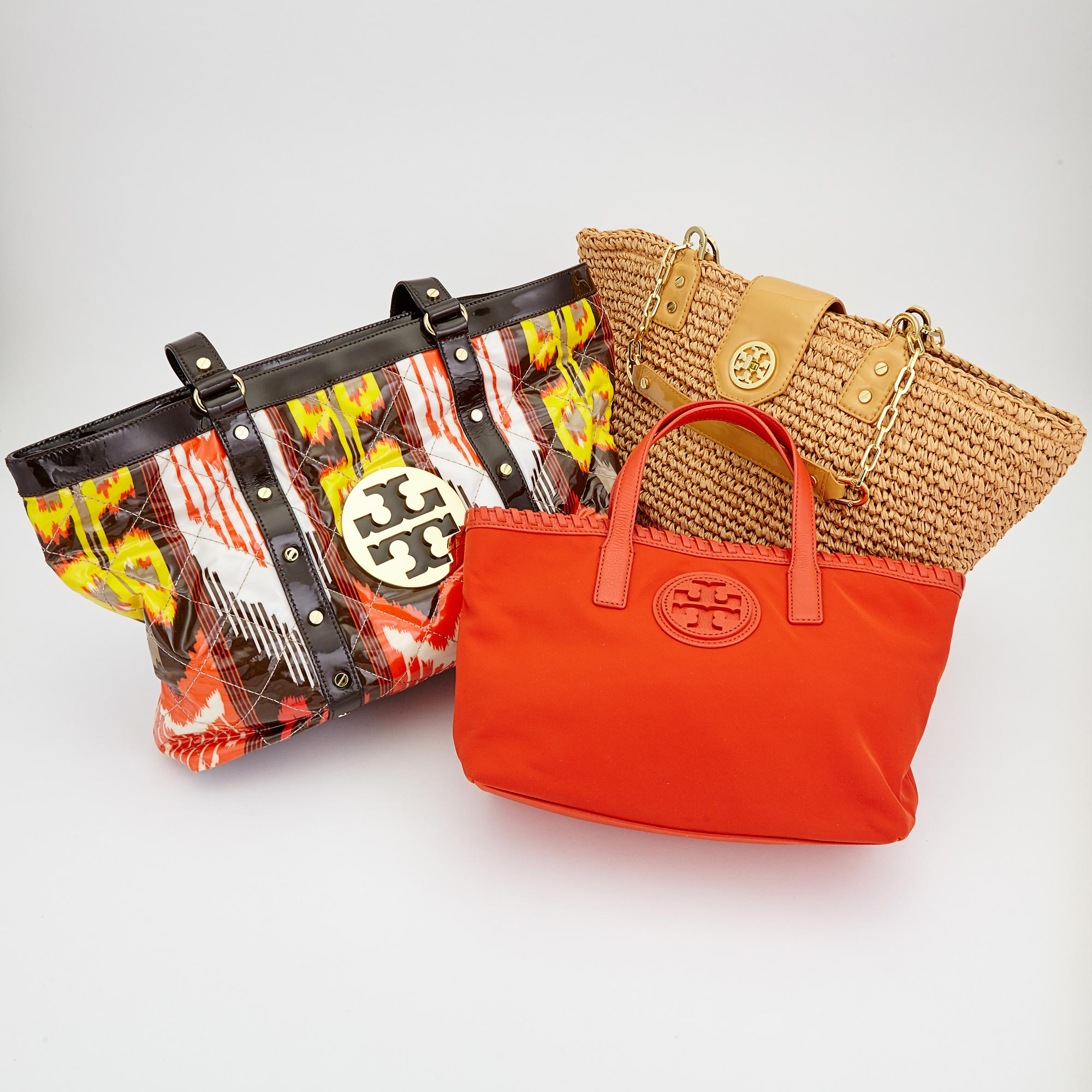 Lot image - Three Natural Straw, Red Fabric and Multicolored Laminated Fabric Tote Bags, Tory Burch