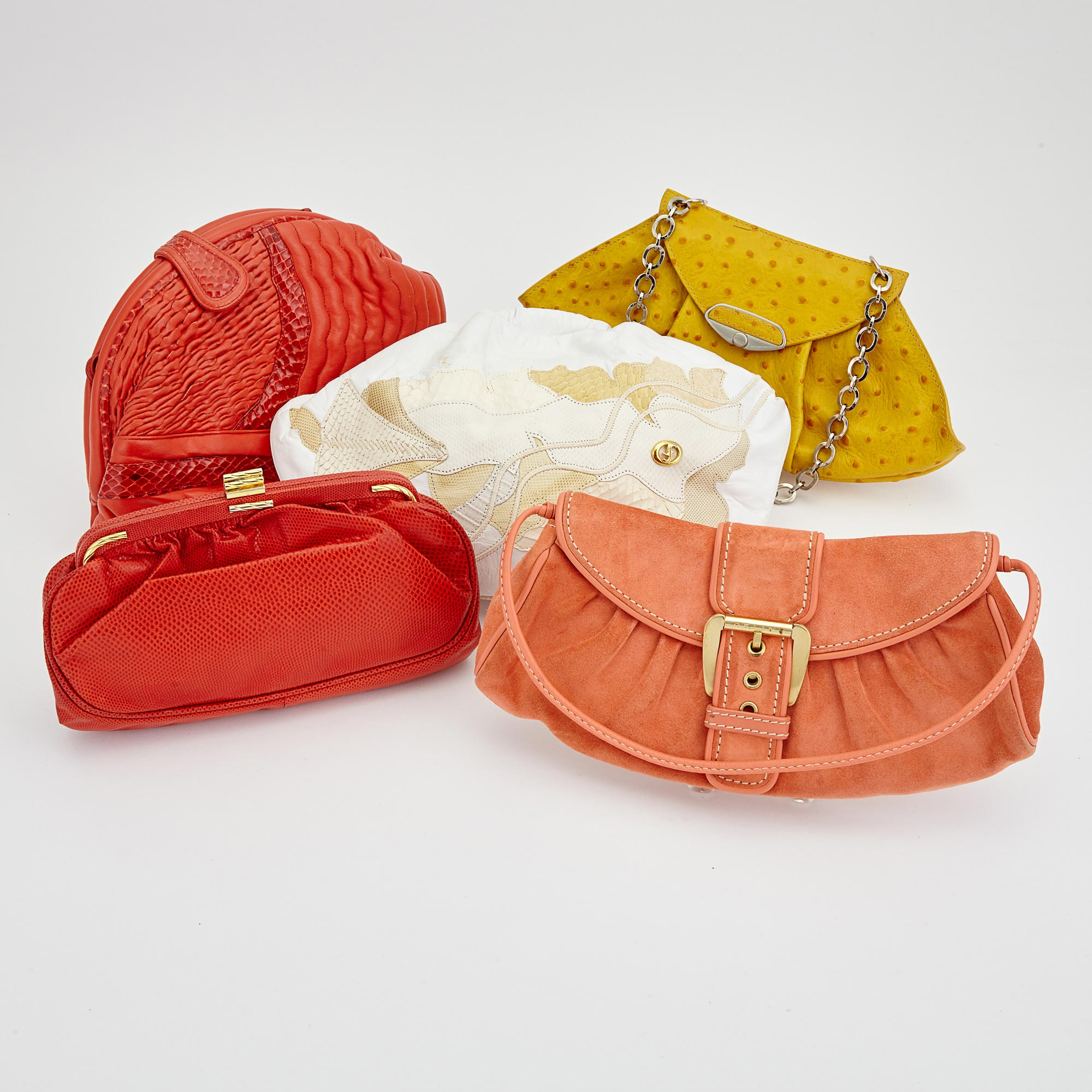 Lot image - Yellow Ostrich Handbag, Furla, Coral Suede Handbag, Celine, and Three Leather Clutches, Carlo Fiori, Susan Gail and Sharif