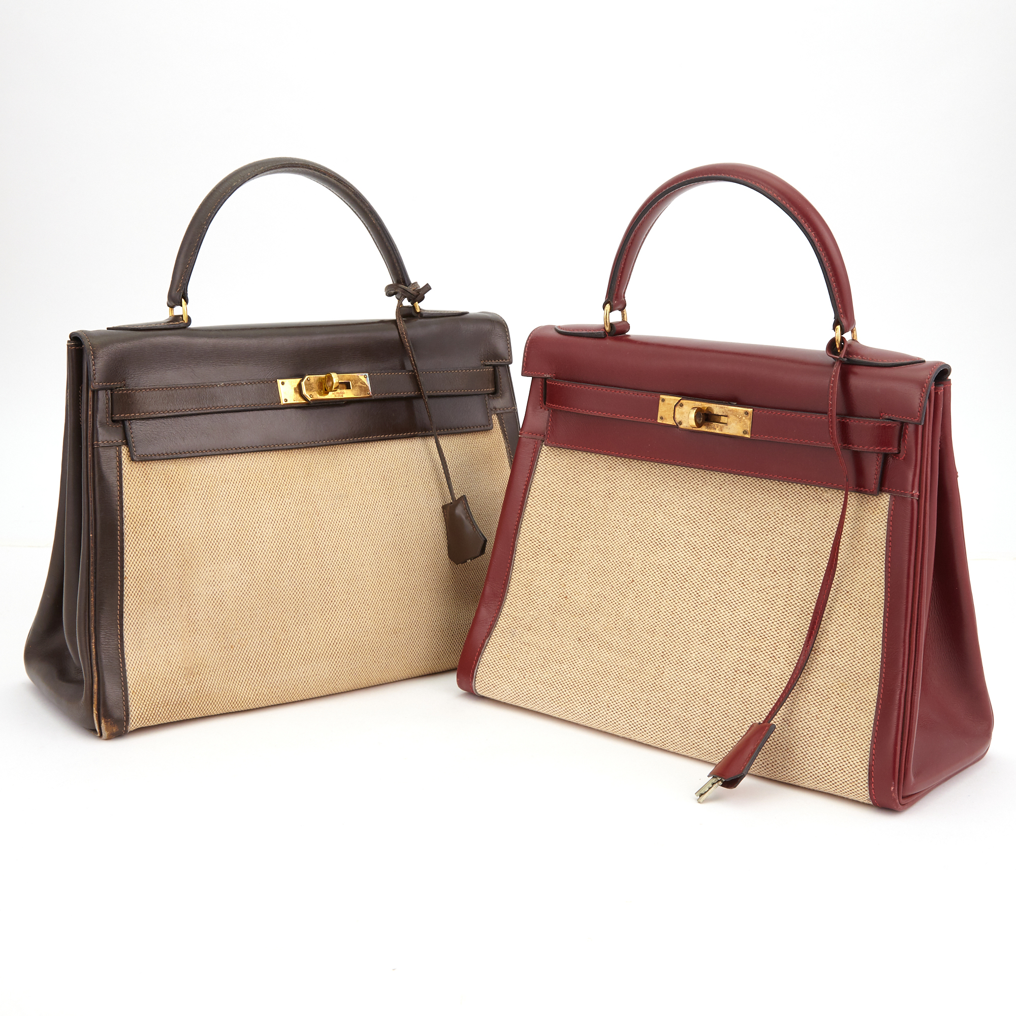 Lot image - Hermés Burgandy Calfskin and Canvas Kelly 28 Handbag and Hermés Chocolate Calfskin and Canvas Kelly 32 Handbag