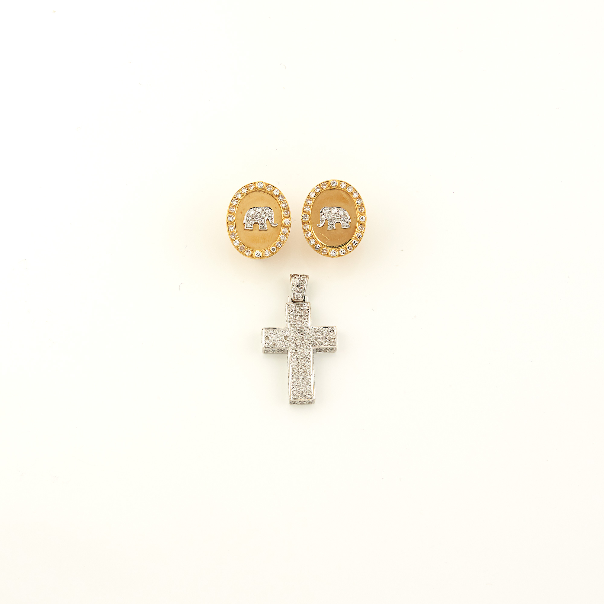 Lot image - Pair of Gold and Diamond Elephant Earclips and White Gold and Diamond Cross Pendant