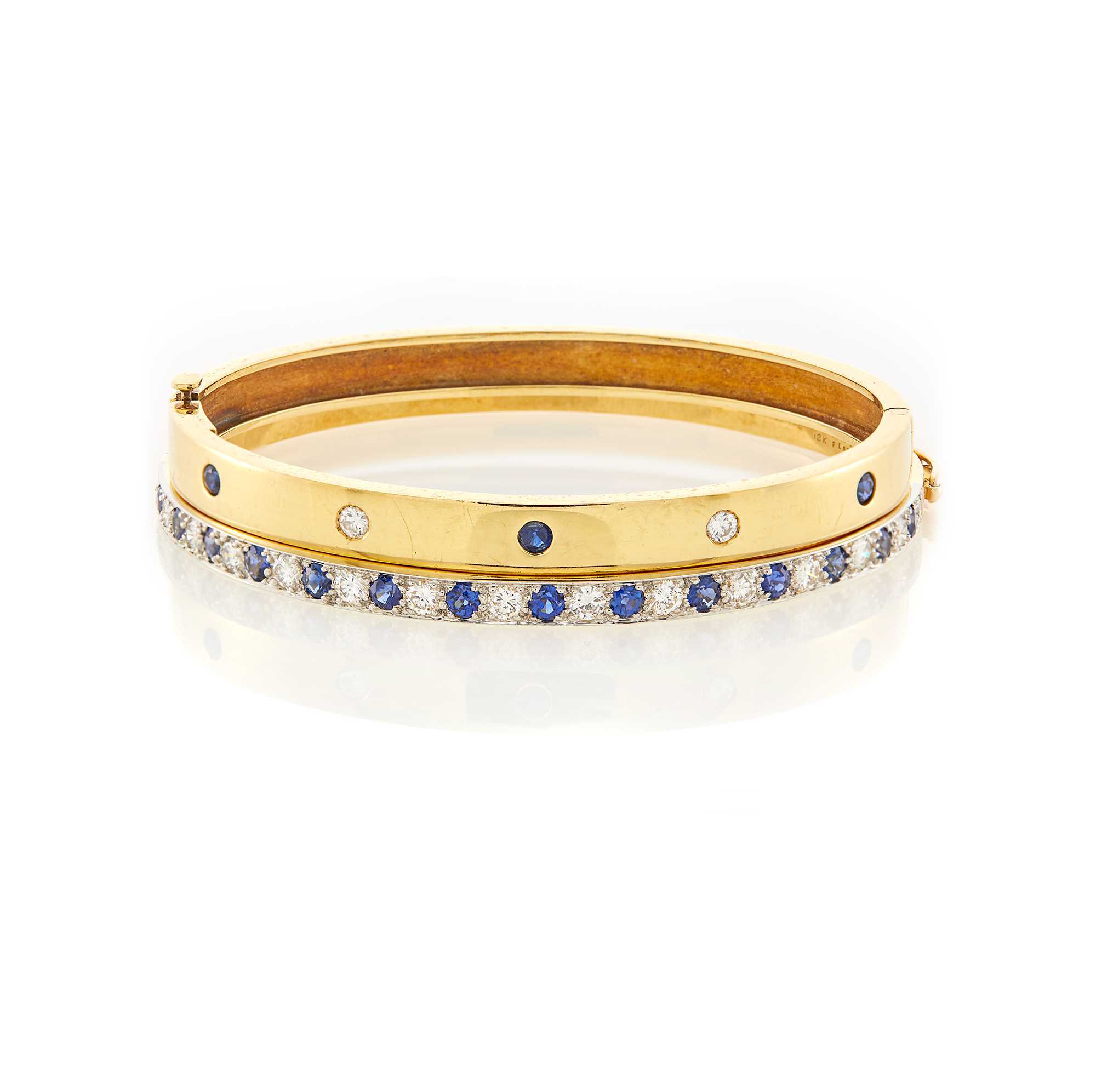 Lot image - Cartier Gold, Sapphire and Diamond Bangle Bracelet and Gold, Platinum, Diamond and Sapphire Bangle Bracelet