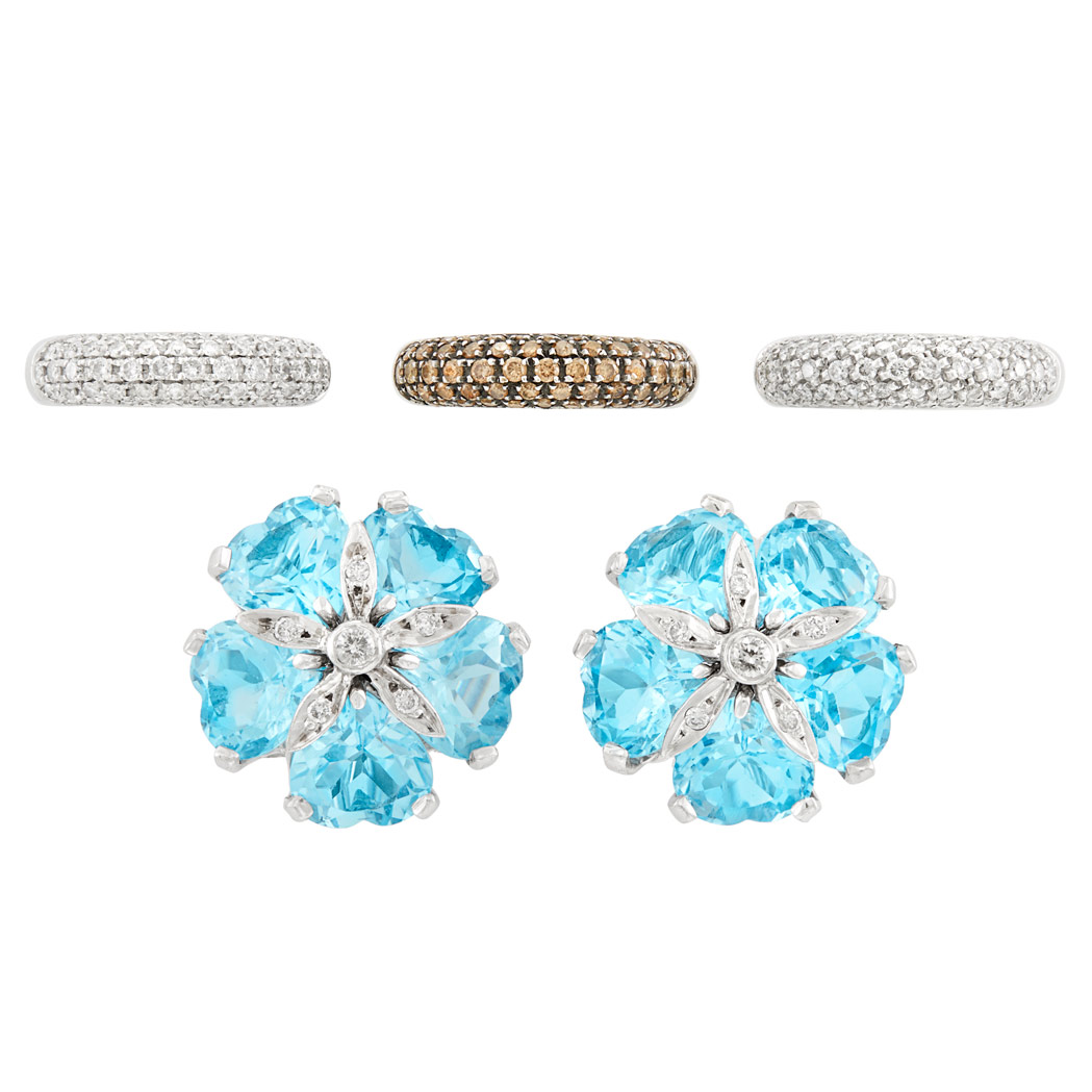 Lot image - Pair of White Gold, Blue Topaz and Diamond Earclips and Three White Gold, Diamond and Brown Diamond Bombé Rings