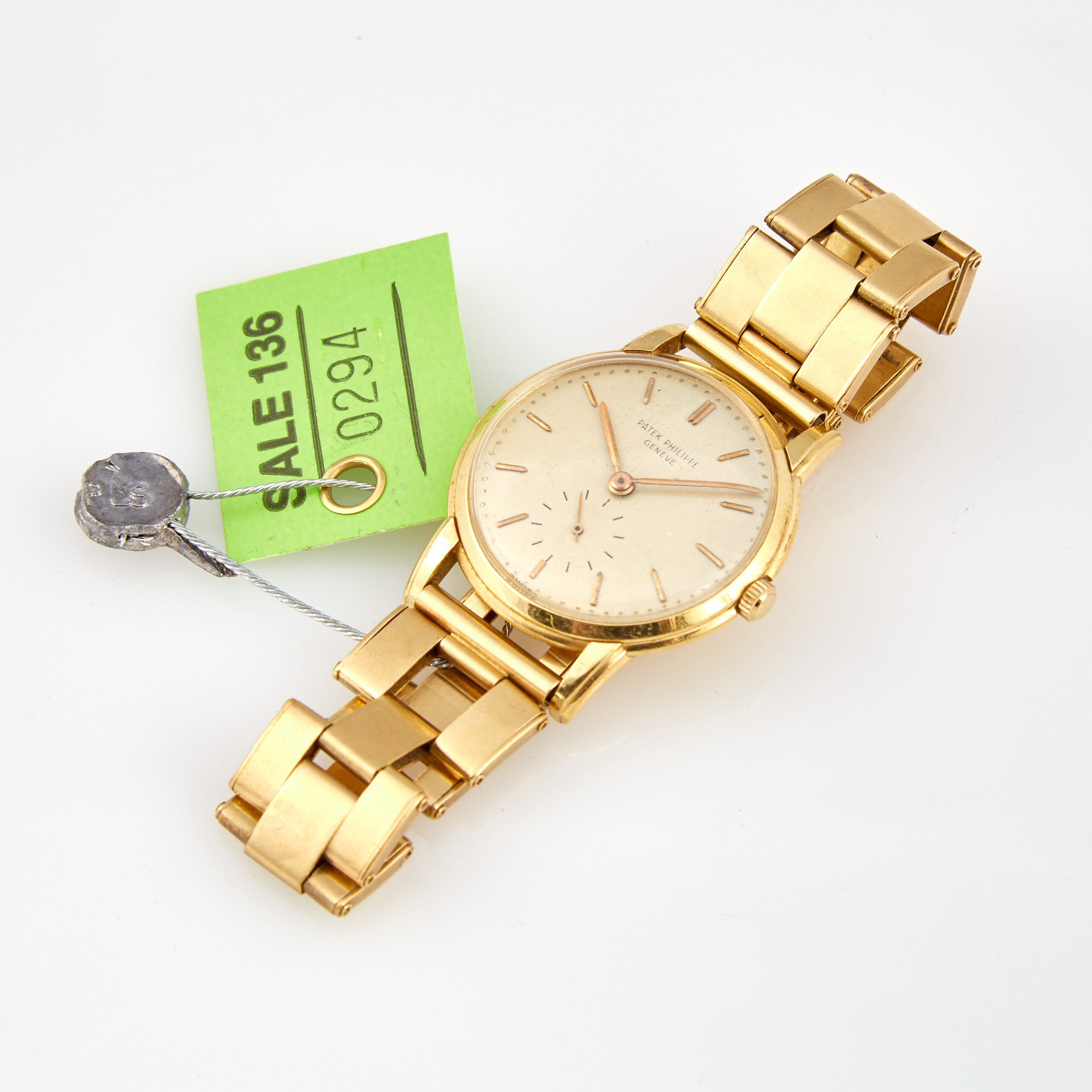 Lot image - Mans Gold Wrist Watch, Patek Philippe, Quartz with gold band attached, 18K 40 dwt. all