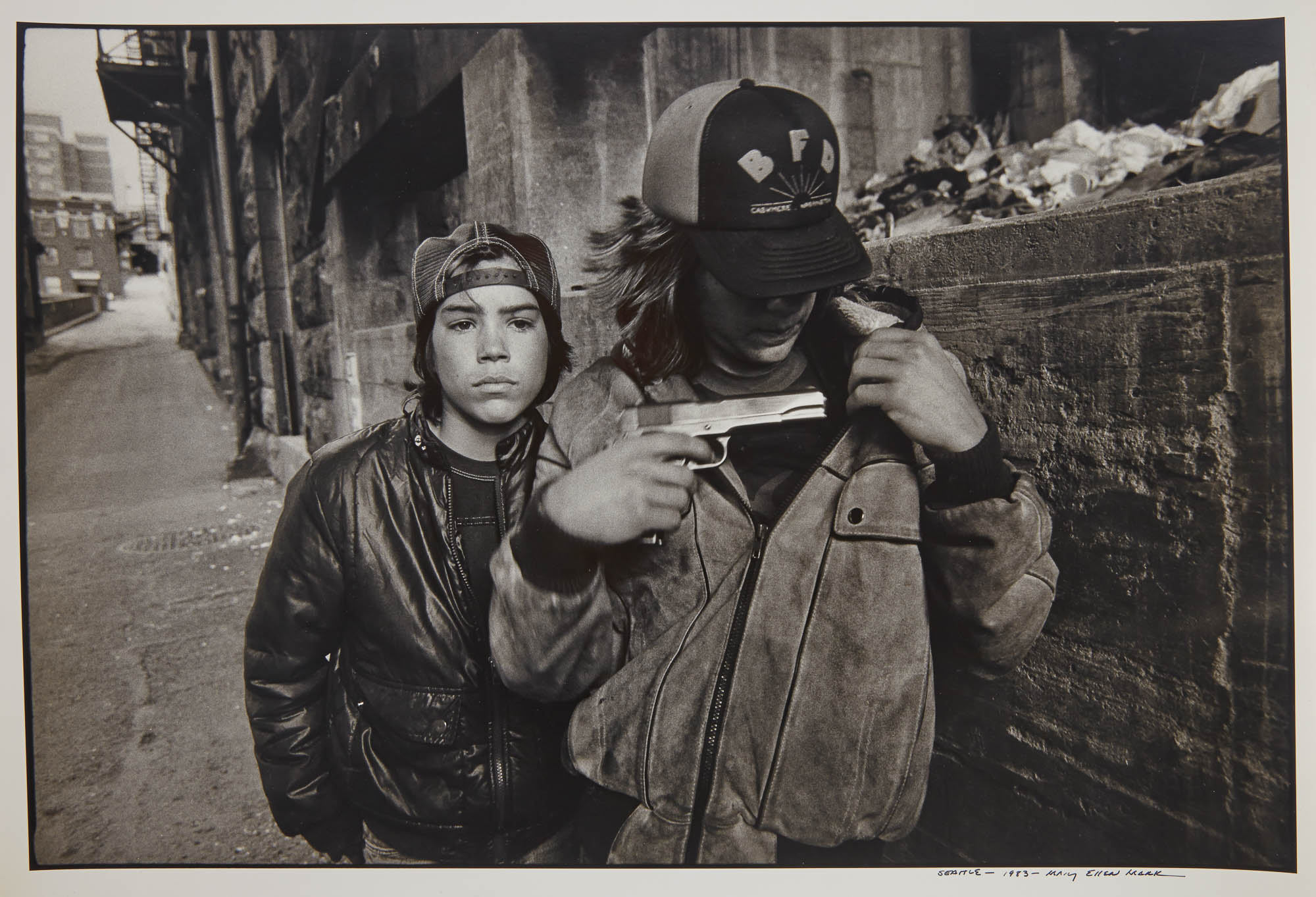 Lot image - MARK, MARY ELLEN (1941-2015)  Seattle, [Rat and Mike with a gun],
