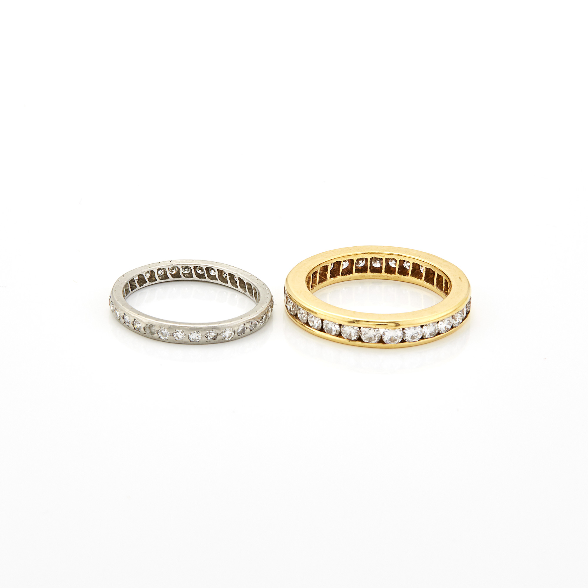 Lot image - Two Gold, Platinum and Diamond Band Rings