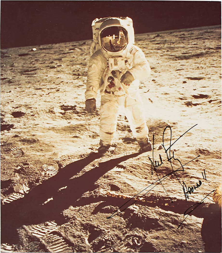 Lot image - [SPACE]  ARMSTRONG, NEIL. Inscribed photograph depicting Buzz Aldrin on the Moon.