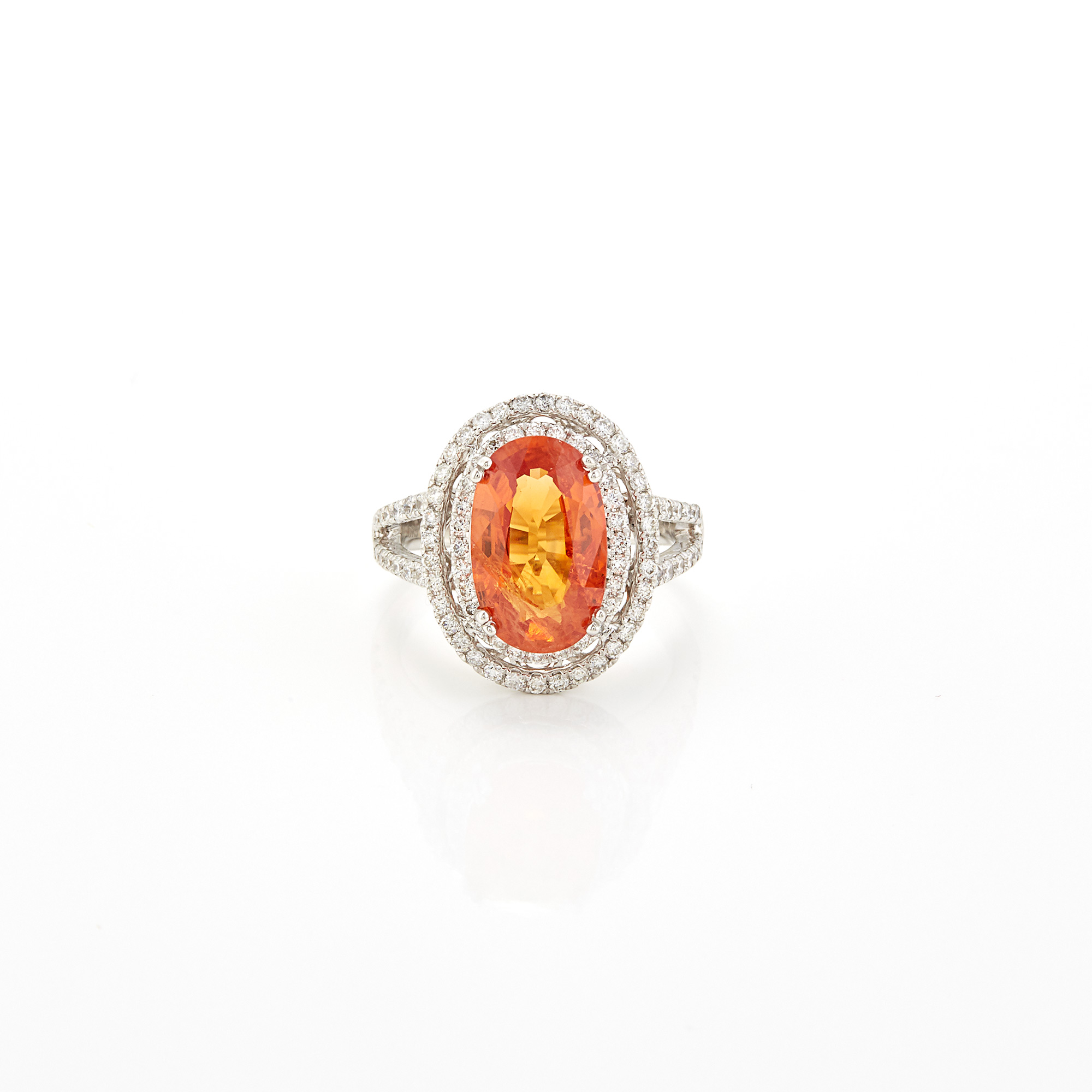 Lot image - White Gold, Orange Sapphire and Diamond Ring
