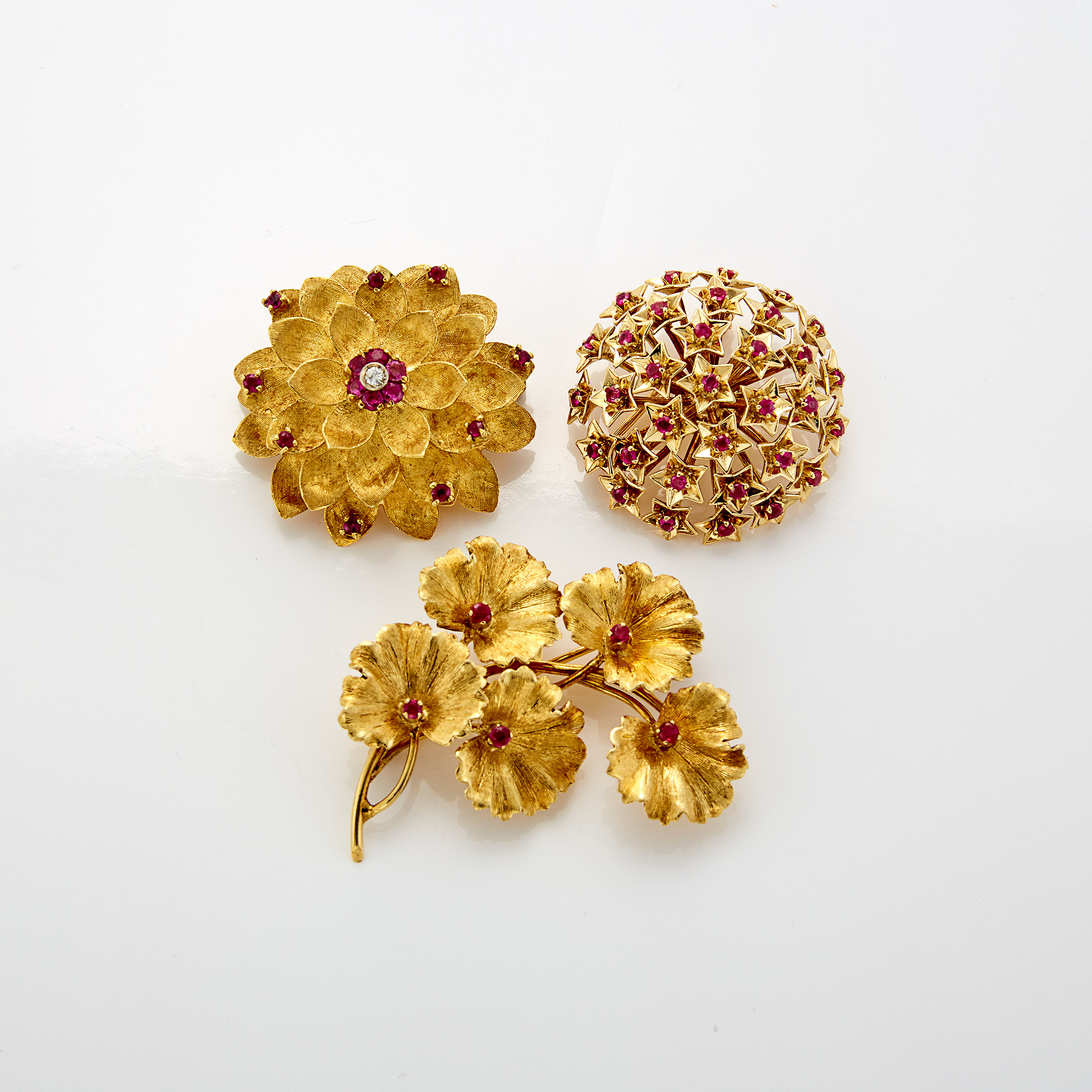 Lot image - Two Gold and Ruby Brooches, Tiffany & Co., Gold, Ruby and Diamond Flower Brooch, Cartier