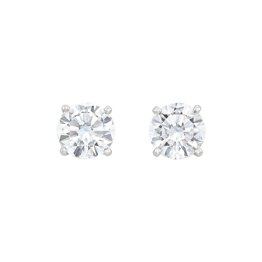 Lot image - Pair of White Gold and Diamond Stud Earrings, Cartier